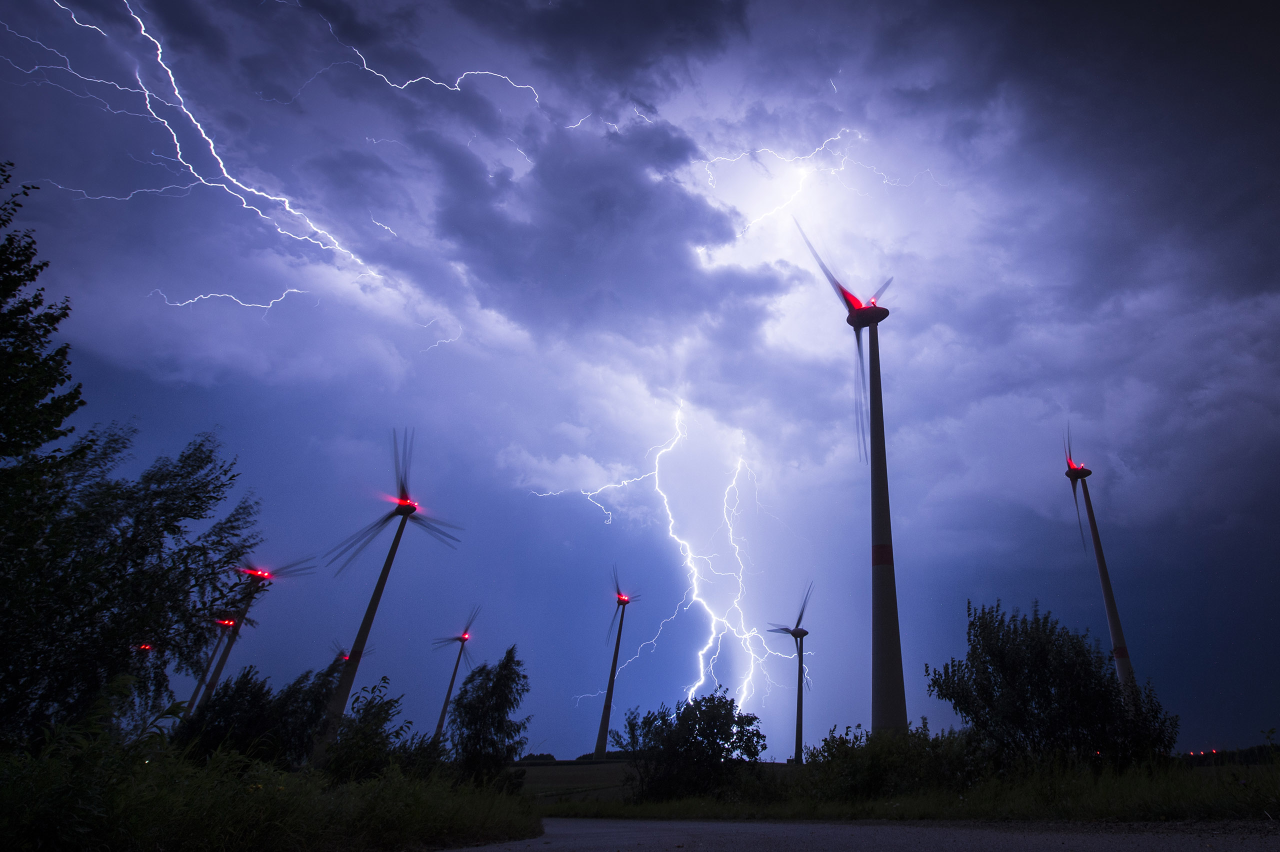 Lightning strikes behind wind turbines during a thunderstorm in Goerlitz, Germany, on Aug. 28, 2016.