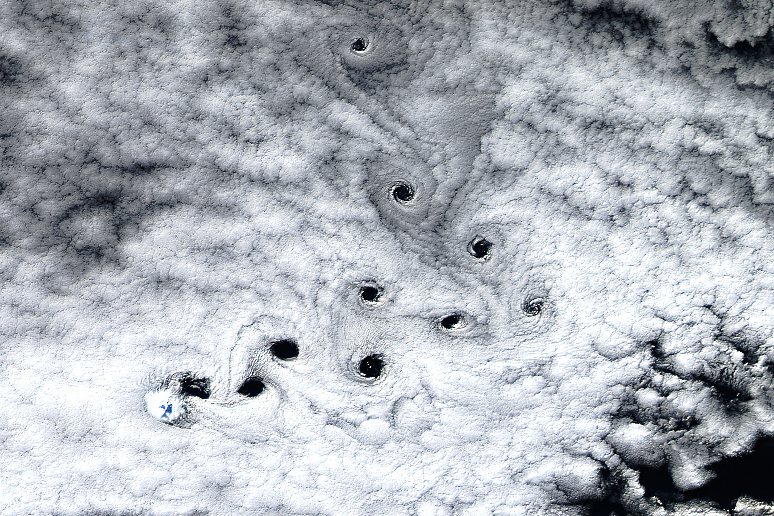 When the Operational Land Imager (OLI) on Landsat 8 captured this image of Heard Island, just the tip of Mawson Peak—the highest point on the island—was visible through the sheet of marine stratocumulus clouds swirling over this part of the Furious Fifties, May 3, 2016.