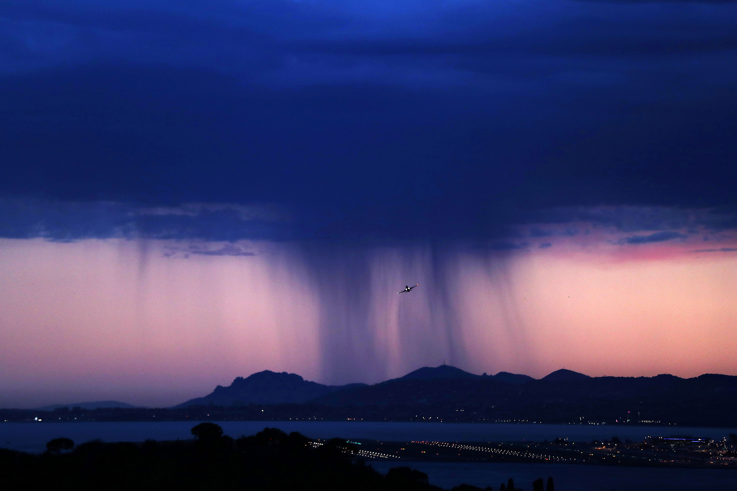 An approaching storm looming over the French riviera city of Nice, in southeastern France, on July 14, 2016.