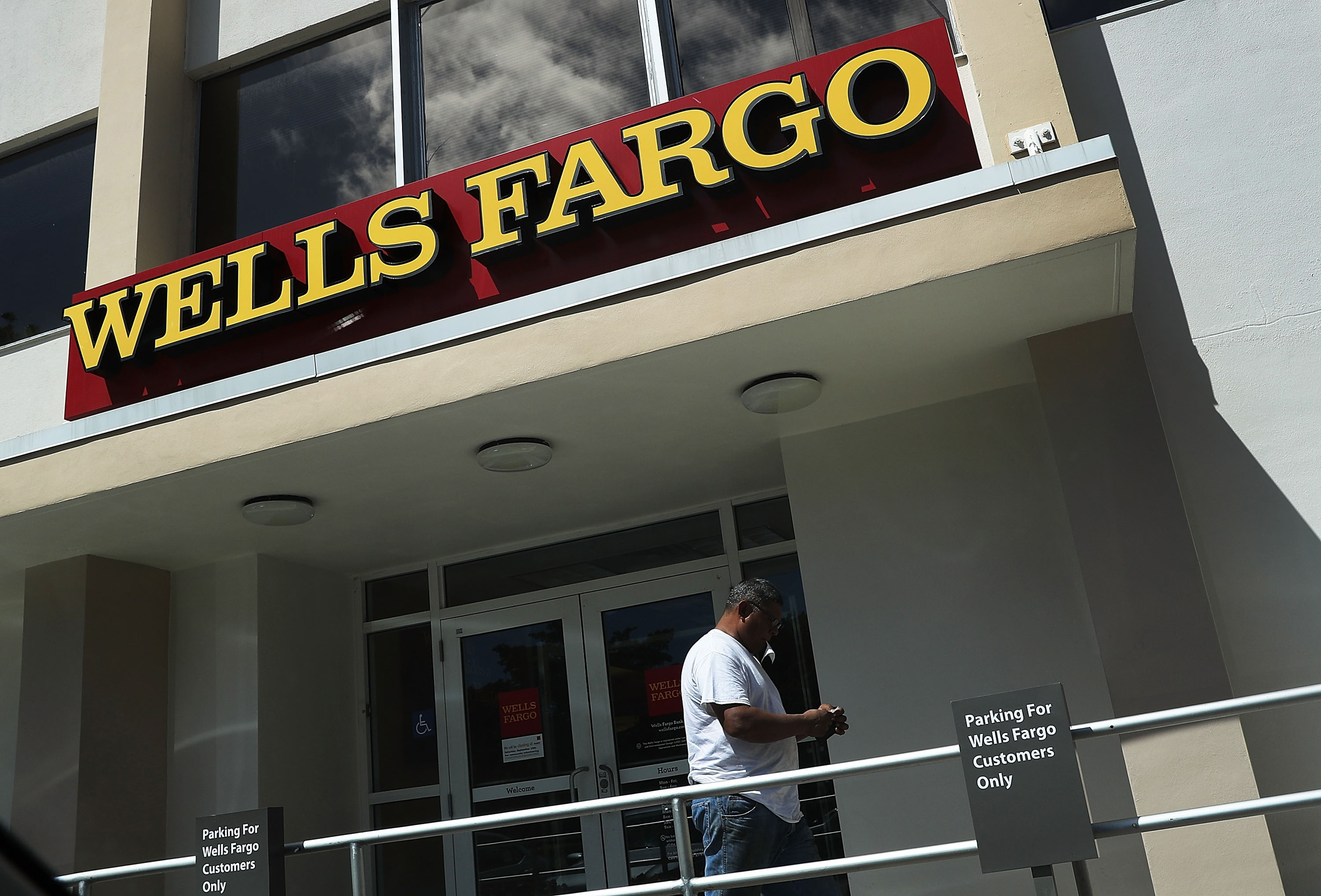 A Wells Fargo sign is seen on the exterior of one of their bank branches in Miami on September 9, 2016.