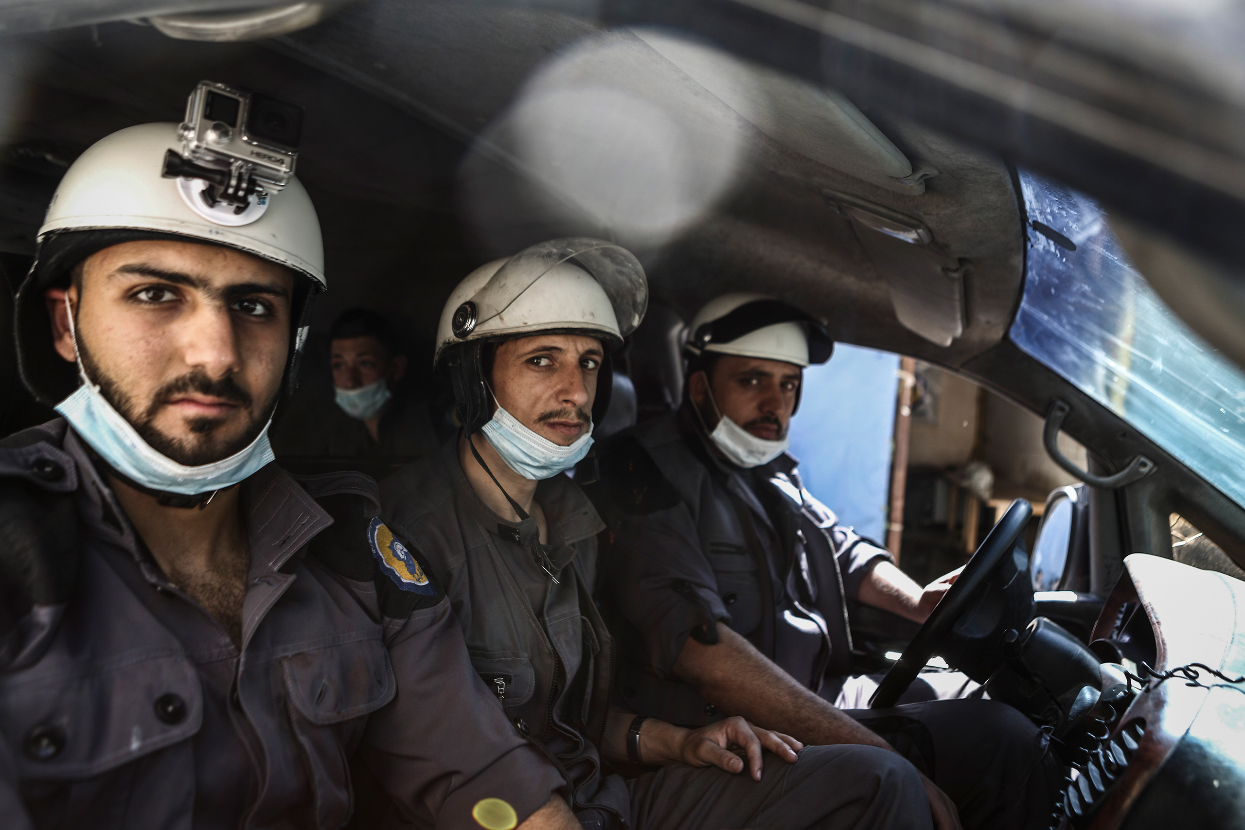 Three members of the White Helmets arrive at the site of an airstrike in Douma on Oct. 5, 2016.From  The White Helmets of Syria.  Oct. 17, 2016 issue.