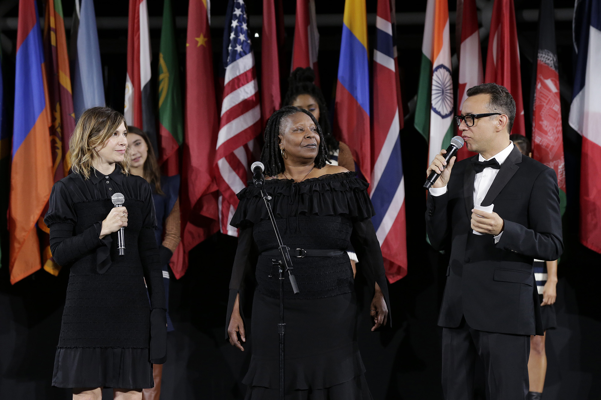 Carrie Brownstein, Whoopi Goldberg, and Fred Armisen speak onstage during the Opening Ceremony fashion show during New York Fashion Week at Jacob Javits Center on September 11, 2016 in New York City.  (Photo by JP Yim/Getty Images)