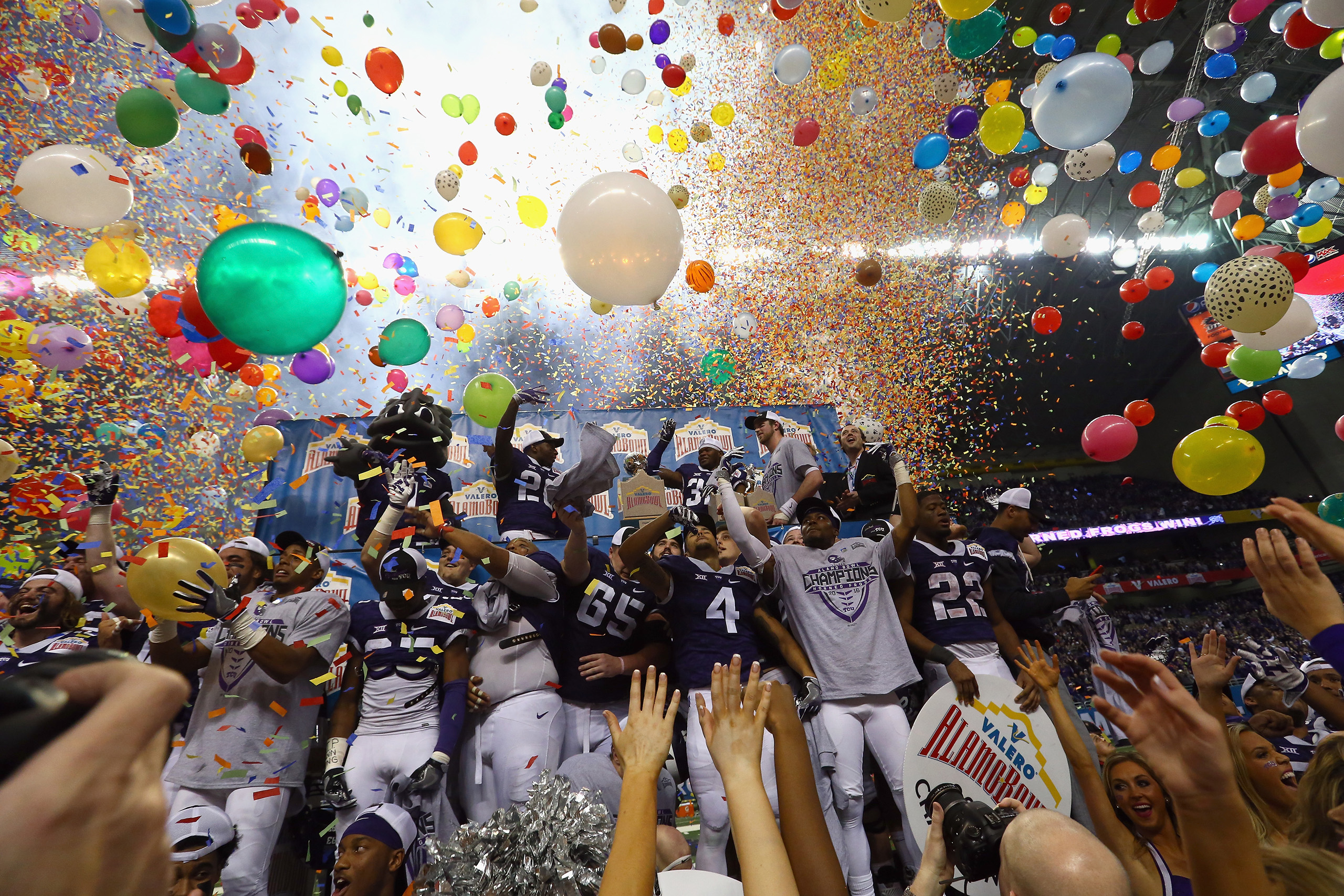 The TCU Horned Frogs celebrate after winning the Valero Alamo Bowl in three overtimes against the Oregon Ducks at Alamodome on Jan. 2, 2016 in San Antonio.