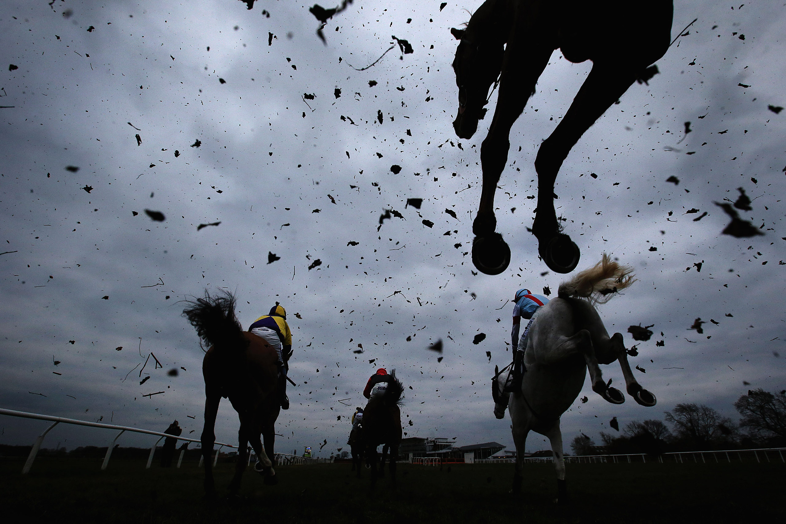 Horses clear a fence during the Racing UK Profits Returned To Racing Handicap Steeple Chase at Wetherby Racecourse on March 22, 2016 in Wetherby, England.