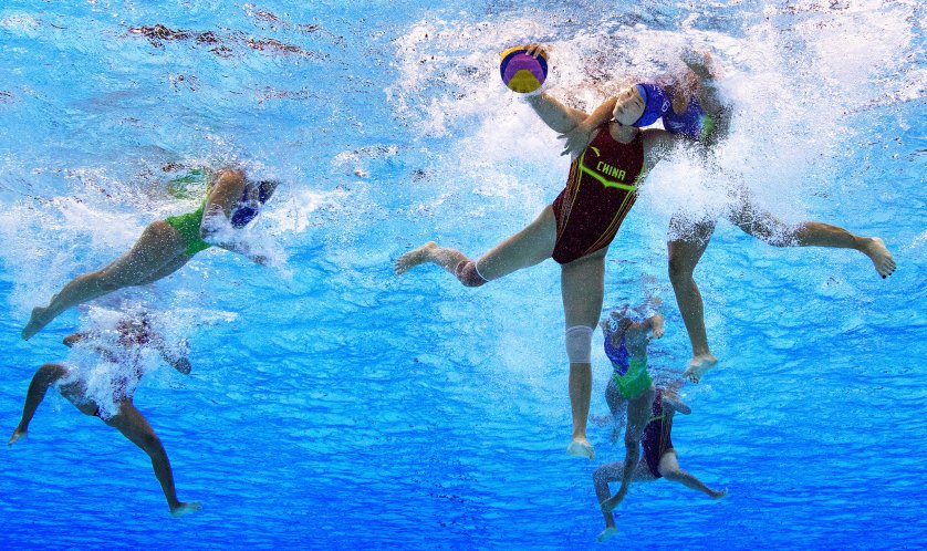 Sun Yating of China is challenged during the Women's Water Polo 7th - 8th Classification match between Brazil and China on Day 14 of the Rio 2016 Olympic Games at the Olympic Aquatics Stadium on Aug.19, 2016 in Rio de Janeiro.