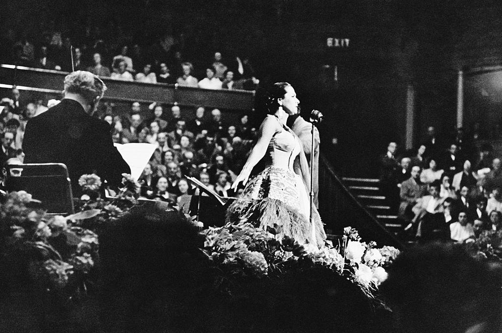 Peruvian soprano Yma Sumac (1922 - 2008) performs at the Royal Albert Hall in London, 1952.