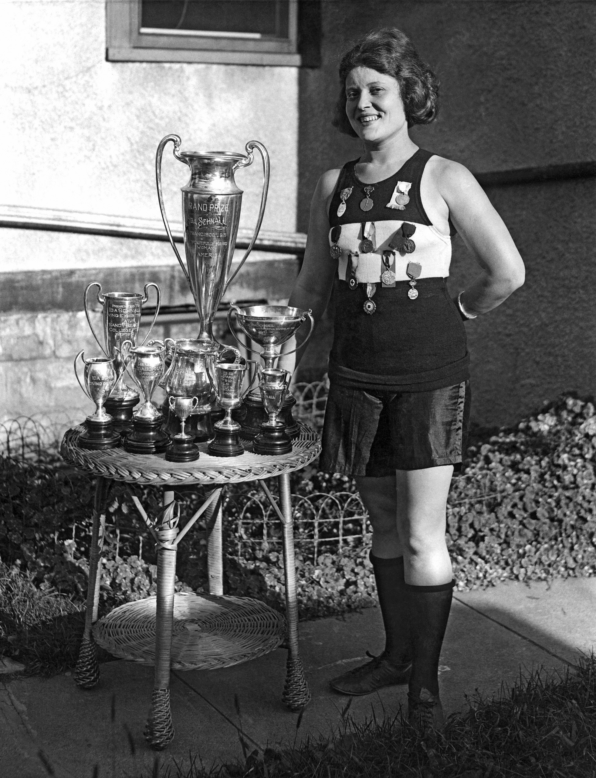 Ida Schnall, America's champion athlete. She was a swimmer, Olympic diver, baseball player, and fitness instructor. The tall trophy was awarded in San Francisco in 1915 for being America's most beautifully formed woman.
