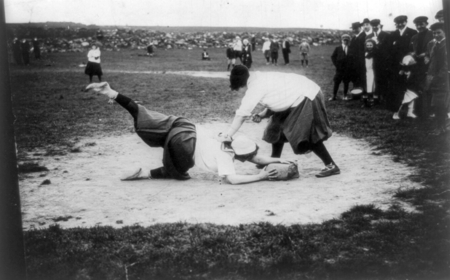 Miss Schnall sliding to first. Miss Morgan on bag. The New York Female Giants, circa 1913.