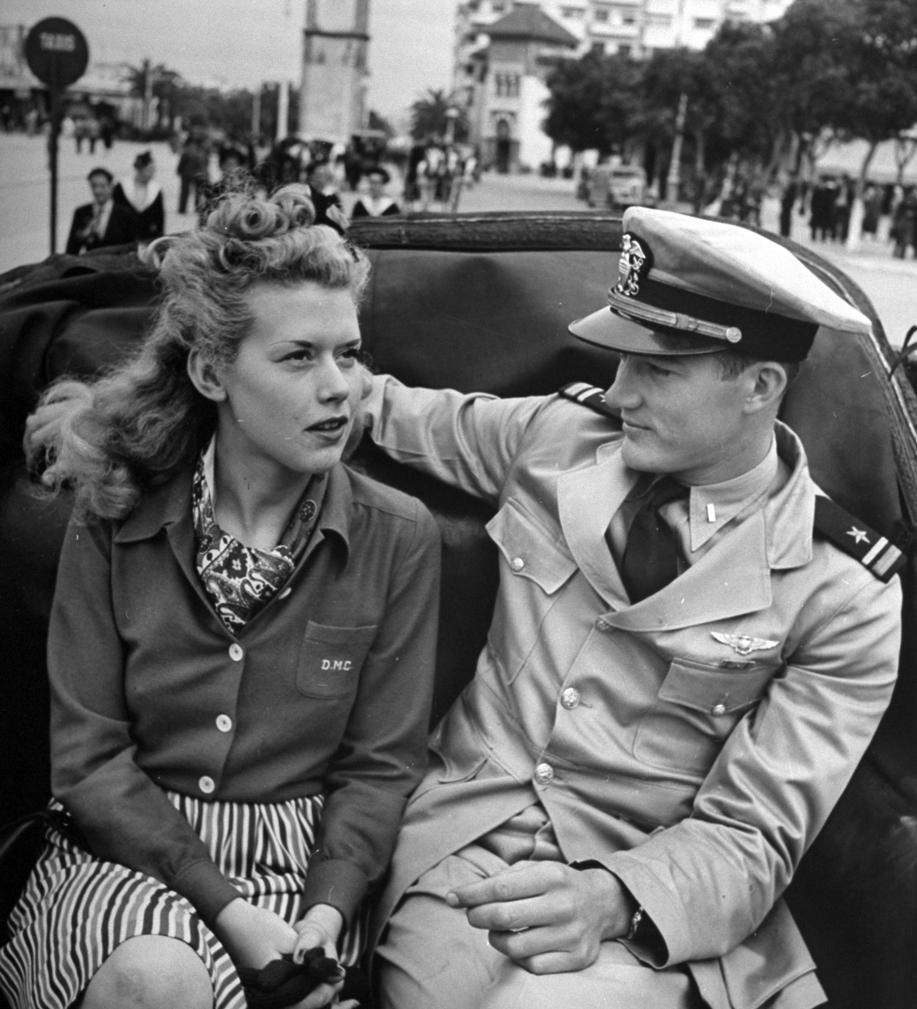 Caption from LIFE. Finding a pretty, clever girl in Casablanca was the feat of a U.S. Navy flier named Jim and he made the most of it.