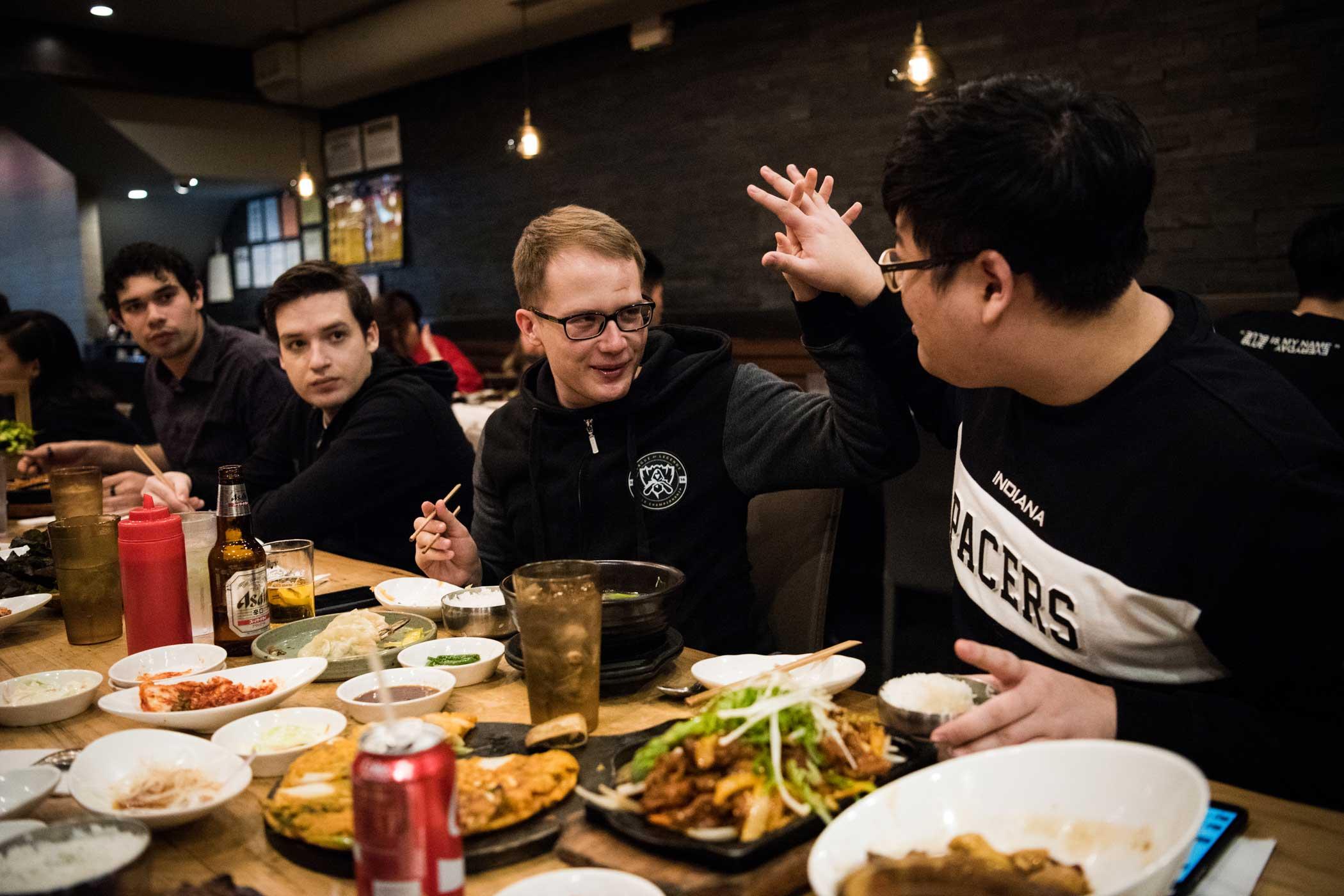 "Oskar ""VandeR"" Bogdan, center, high fives teammate Ryu ""Ryu"" Sang-ook while out to Korean barbecue."