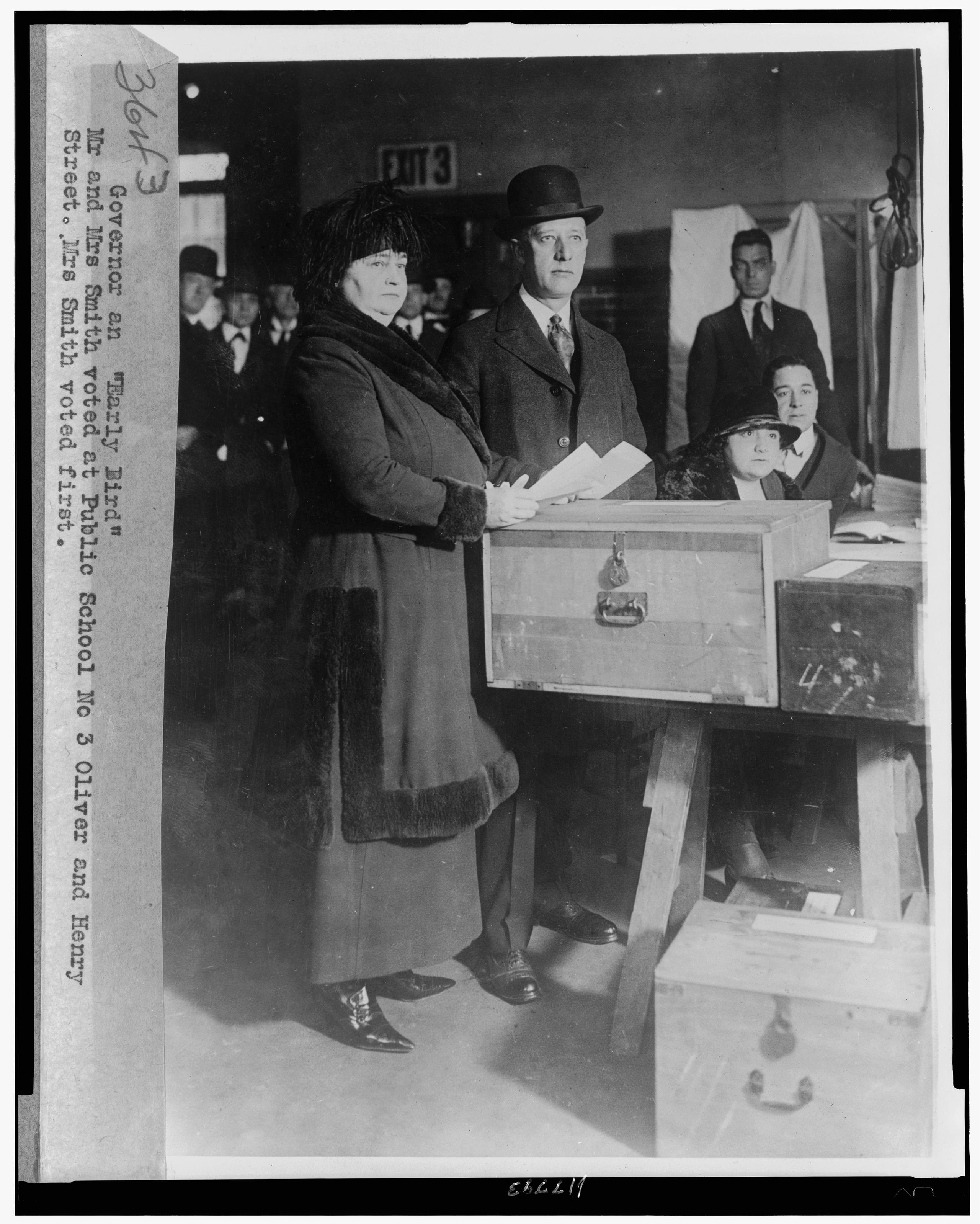 New York Governor Al Smith and his wife voting at Public School No. 3, circa 1928.