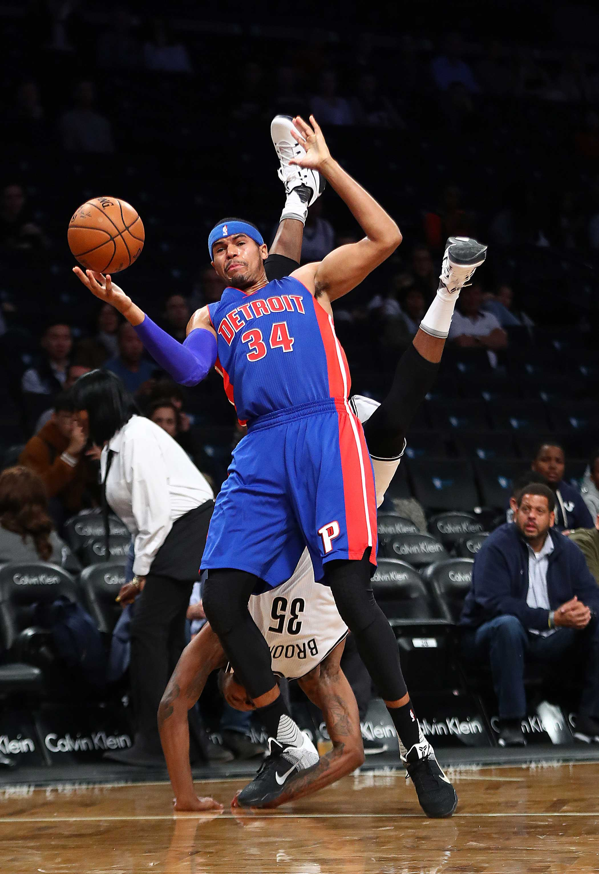 Tobias Harris of the Detroit Pistons and Trevor Booker of the Brooklyn Nets collide going for the ball during their Pre Season game at the Barclays Center on Oct. 6,