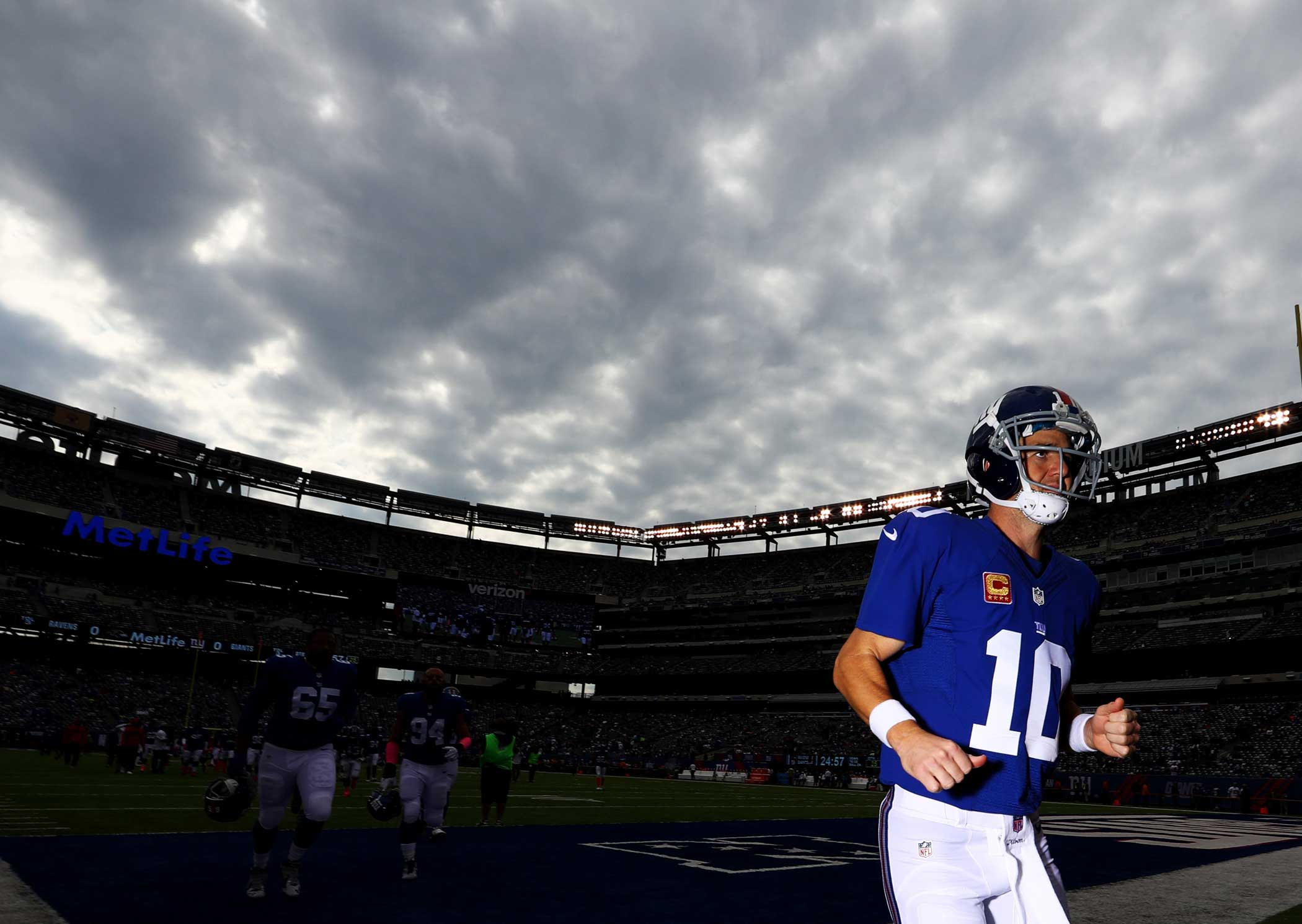 Eli Manning of the New York Giants runs off the field after warmups before the game against the Baltimore Ravens at MetLife Stadium on Oct. 16, 2016 in East Rutherford, New Jersey.