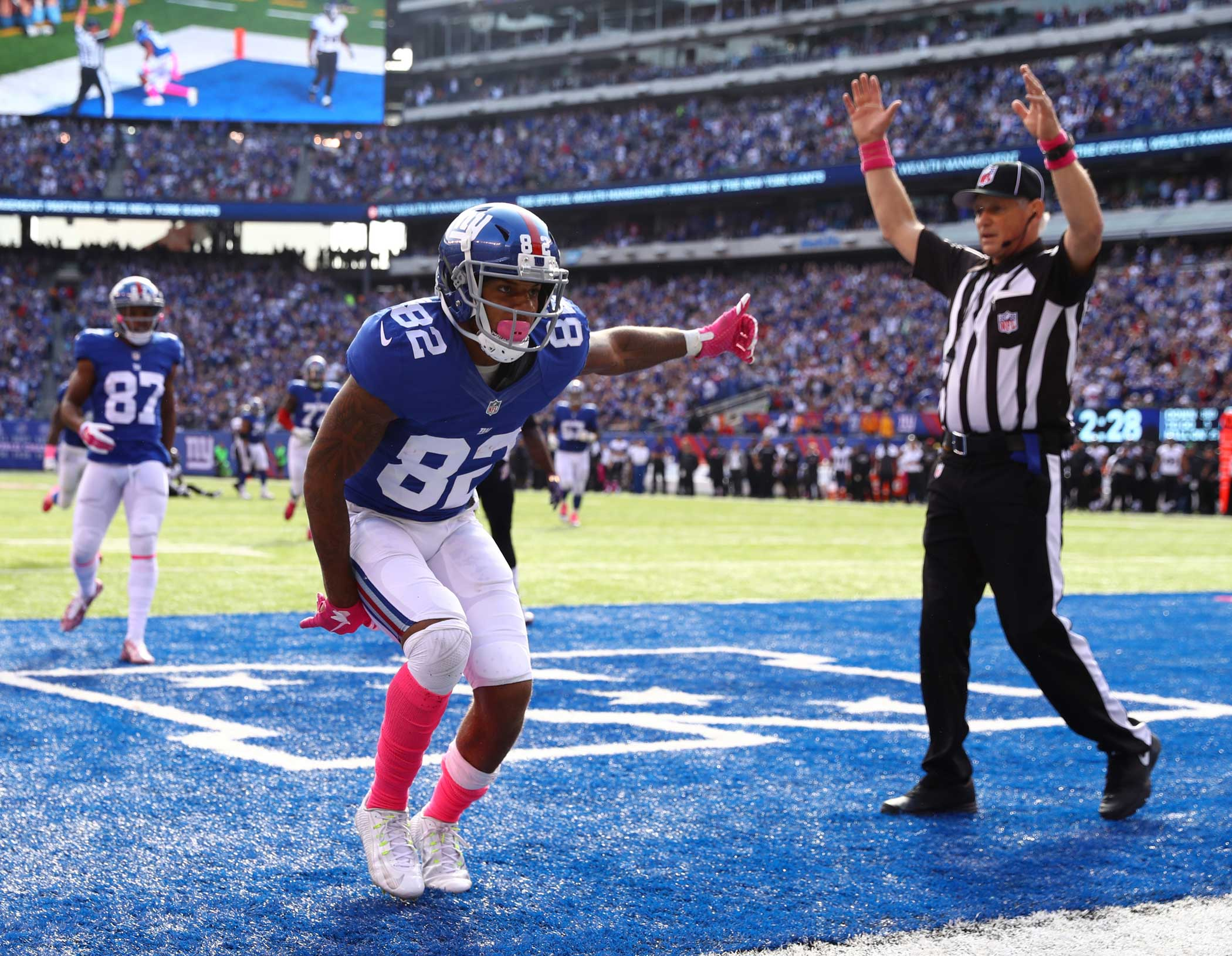Roger Lewis of the New York Giants celebrates a touchdown against Tavon Young of the Baltimore Ravens in the second quarter during their game at MetLife Stadium on Oct. 16, 2016 in East Rutherford, New Jersey.