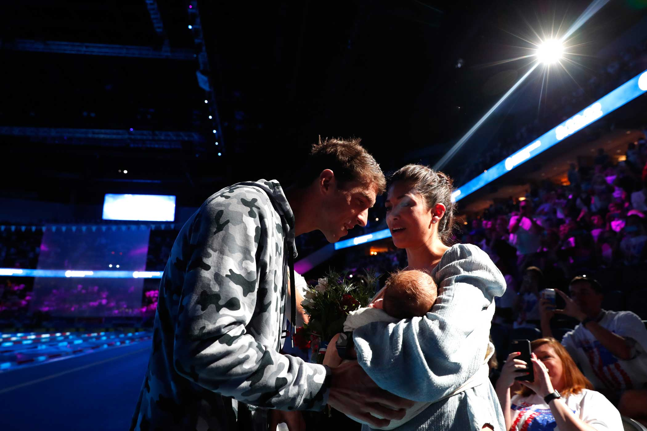 Phelps celebrates with his fiance and their son after finishing first in the final heat for the Men's 200 Meter Individual Medley during the Olympic Trials on July 1, 2016.