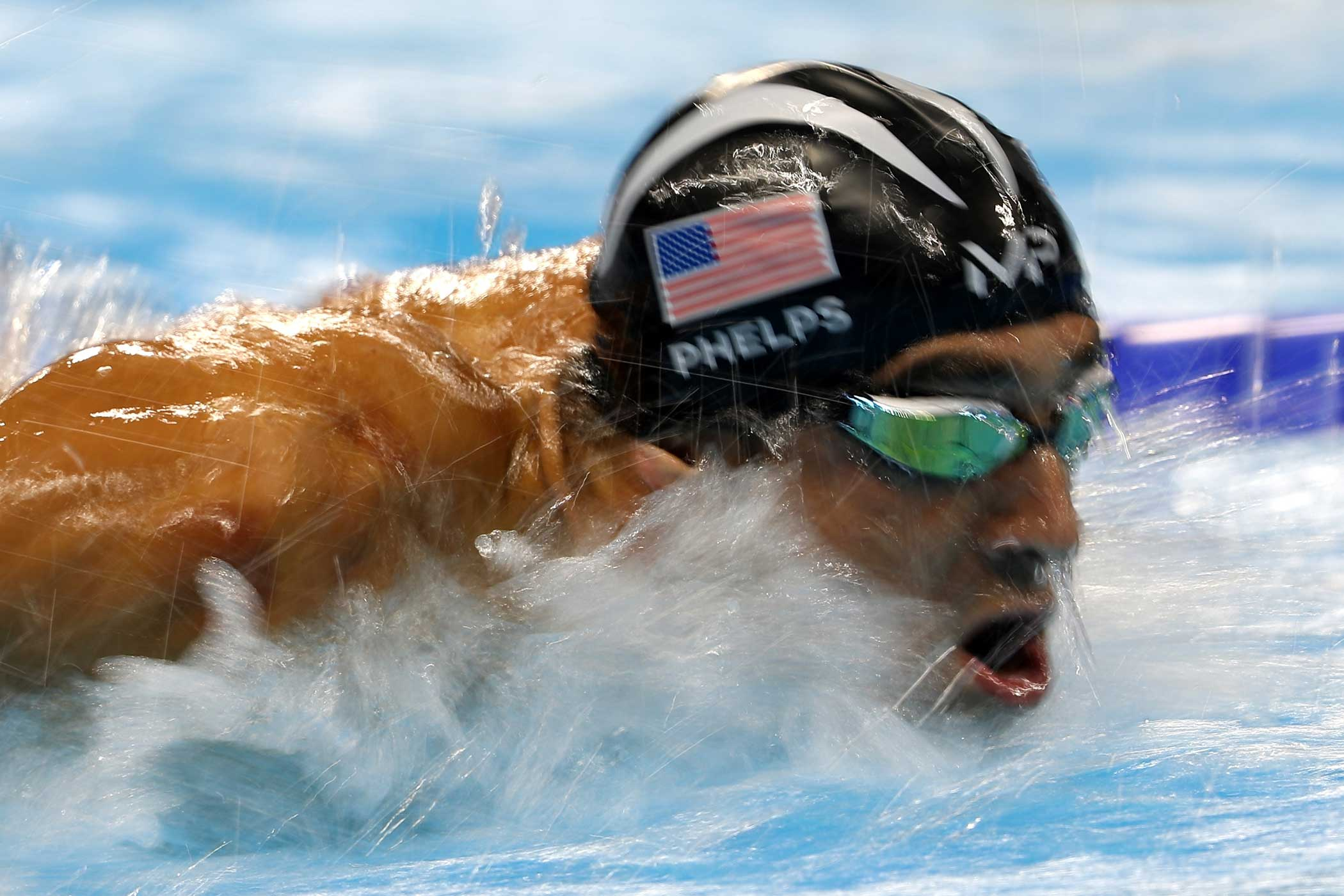 Michael Phelps of the United States competes in the Men's 100m Butterfly Final on August 12.