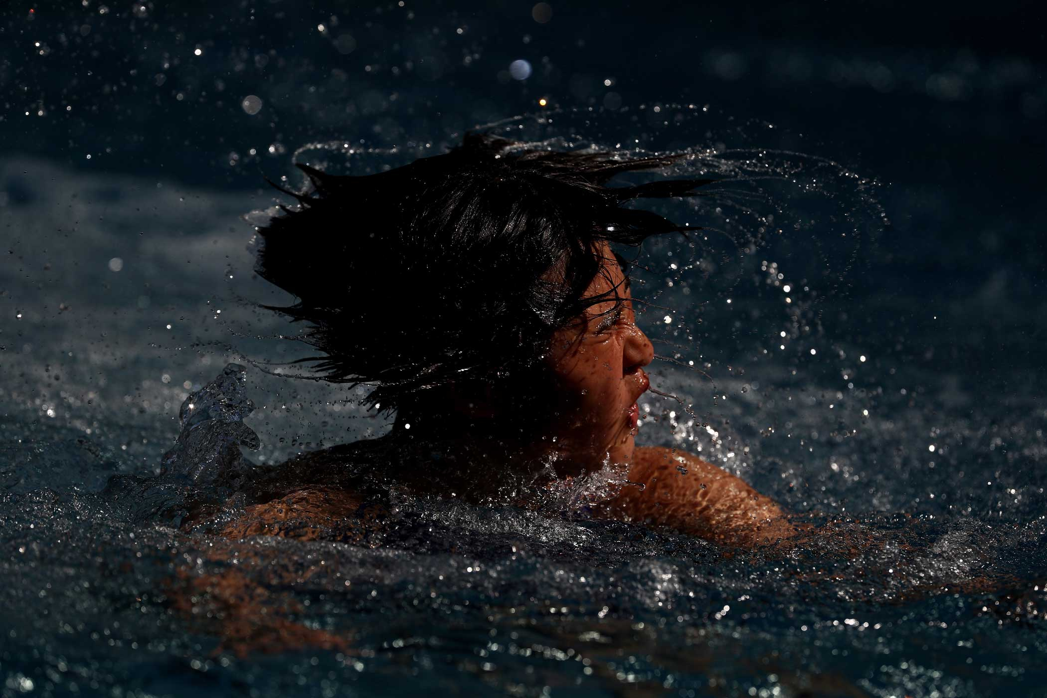 Kim Mi Rae of Democratic People's Republic of Korea practices during a diving training session at the Rio Olympics on Aug. 15.