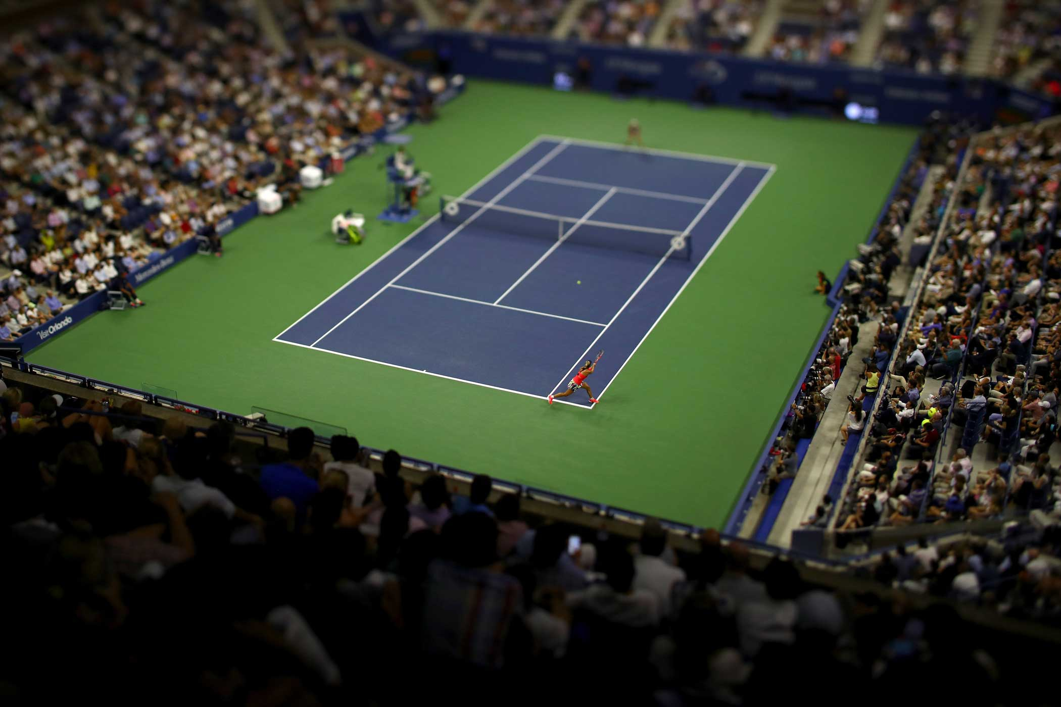 Angelique Kerber of Germany returns a shot to Caroline Wozniacki of Denmark during their Women's Singles Semifinal Match at the US Open.