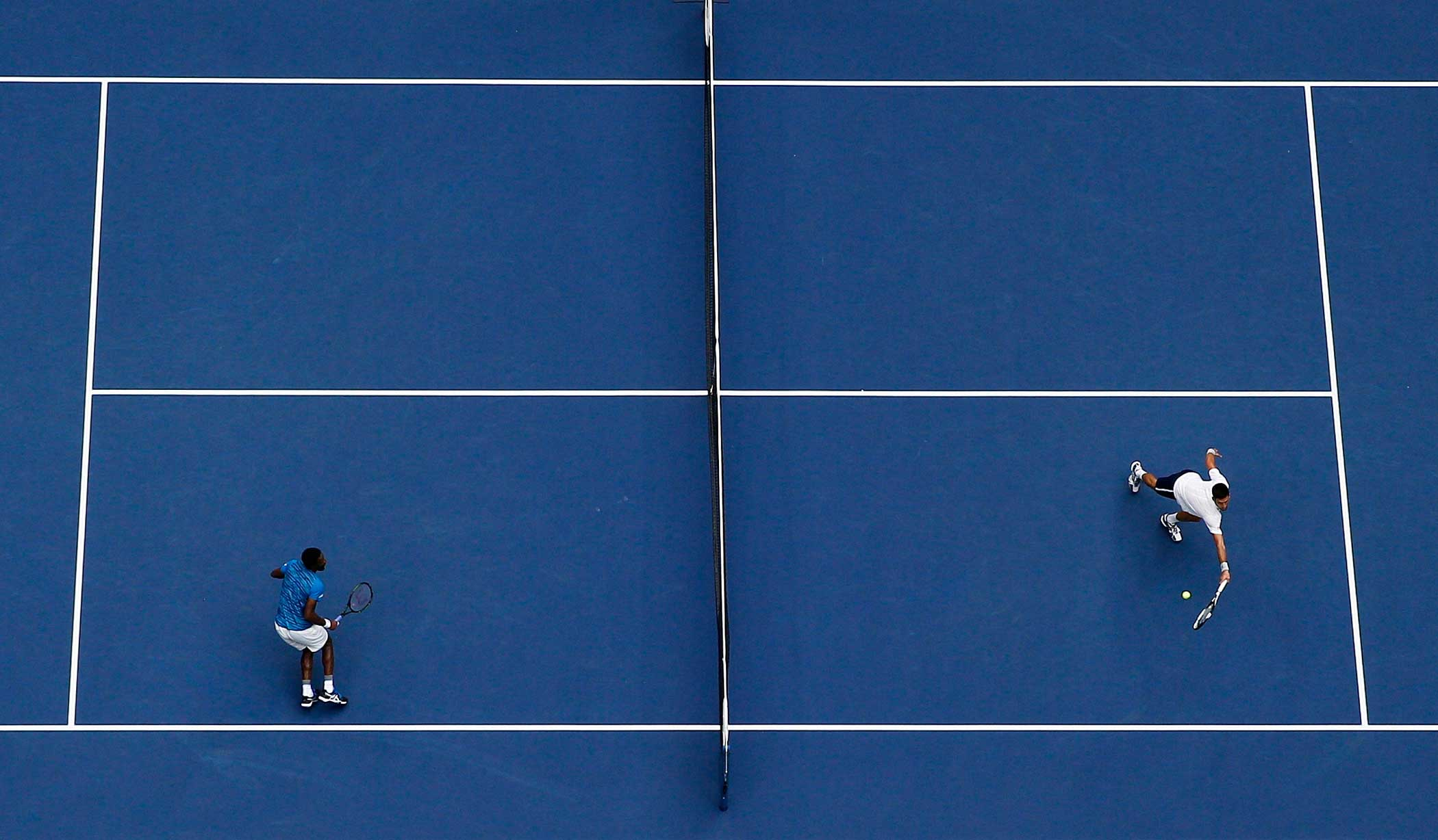 Novak Djokovic of Serbia returns a shot to Gael Monfils of France during their Men's Singles Semifinal Match at the US Open.
