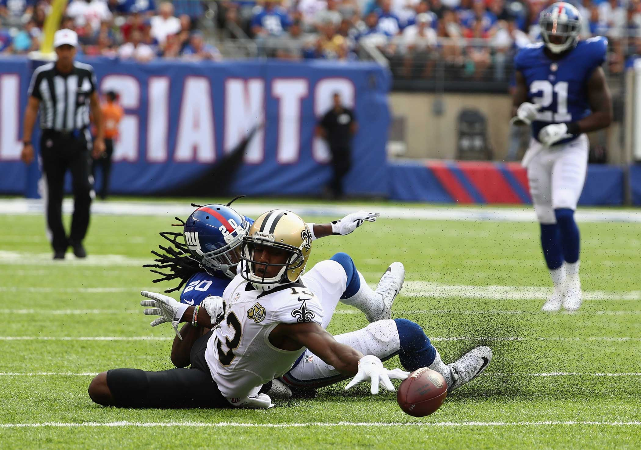 Michael Thomas of the New Orleans Saints reaches for the ball against Janoris Jenkins of the New York Giants during the second half at MetLife Stadium on Sept. 18, 2016 in East Rutherford, New Jersey.