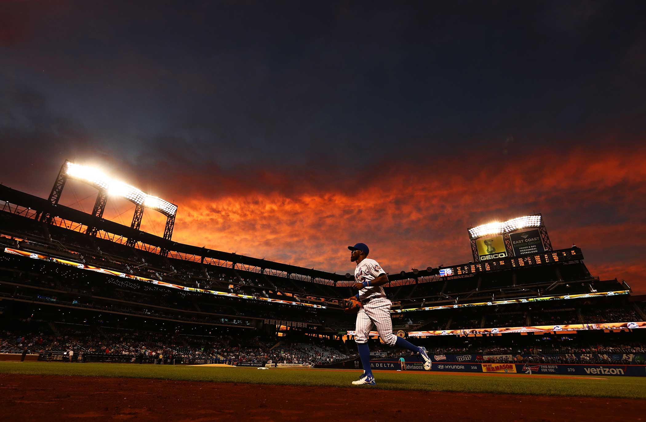 Jose Reyes of the New York Mets jogs to the dugout before the game against the Atlanta Braves at Citi Field on Sept. 21, 2016 in New York City.