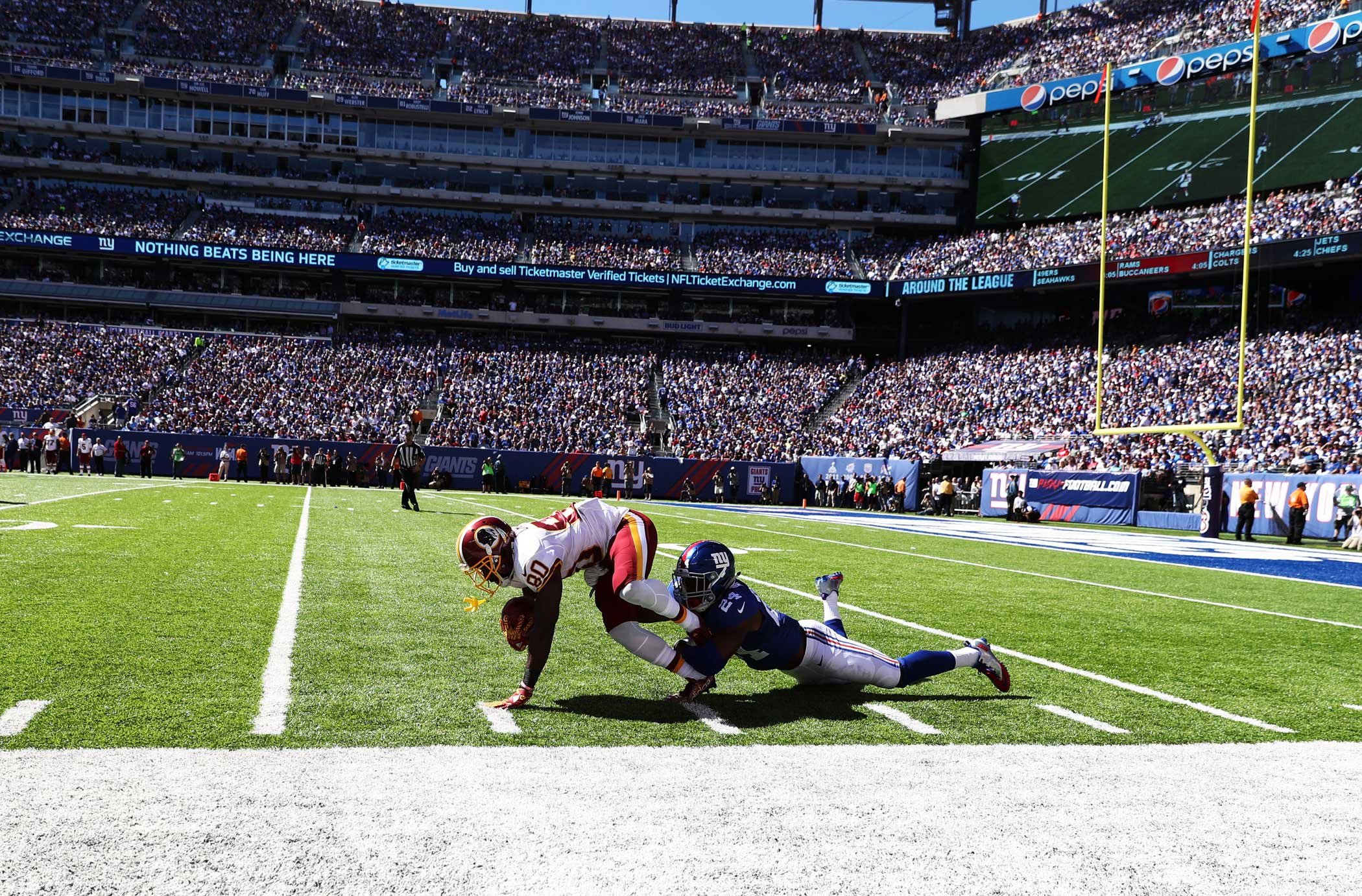 Jamison Crowder of the Washington Redskins escapes a tackle by  Eli Apple of the New York Giants on a punt return during their game at MetLife Stadium on Sept. 25.