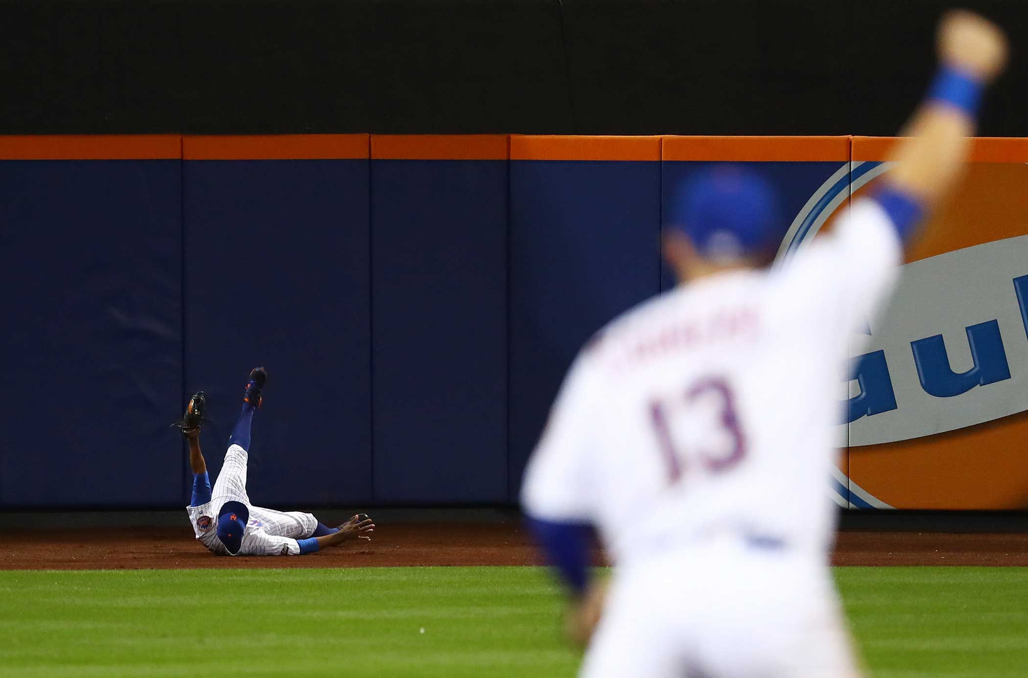 Curtis Granderson of the New York Mets catches a ball hit by Brandon Crawford of the San Francisco Giants for an out in the fifth inning during their National League Wild Card game at Citi Field on Oct. 5 in New York City.