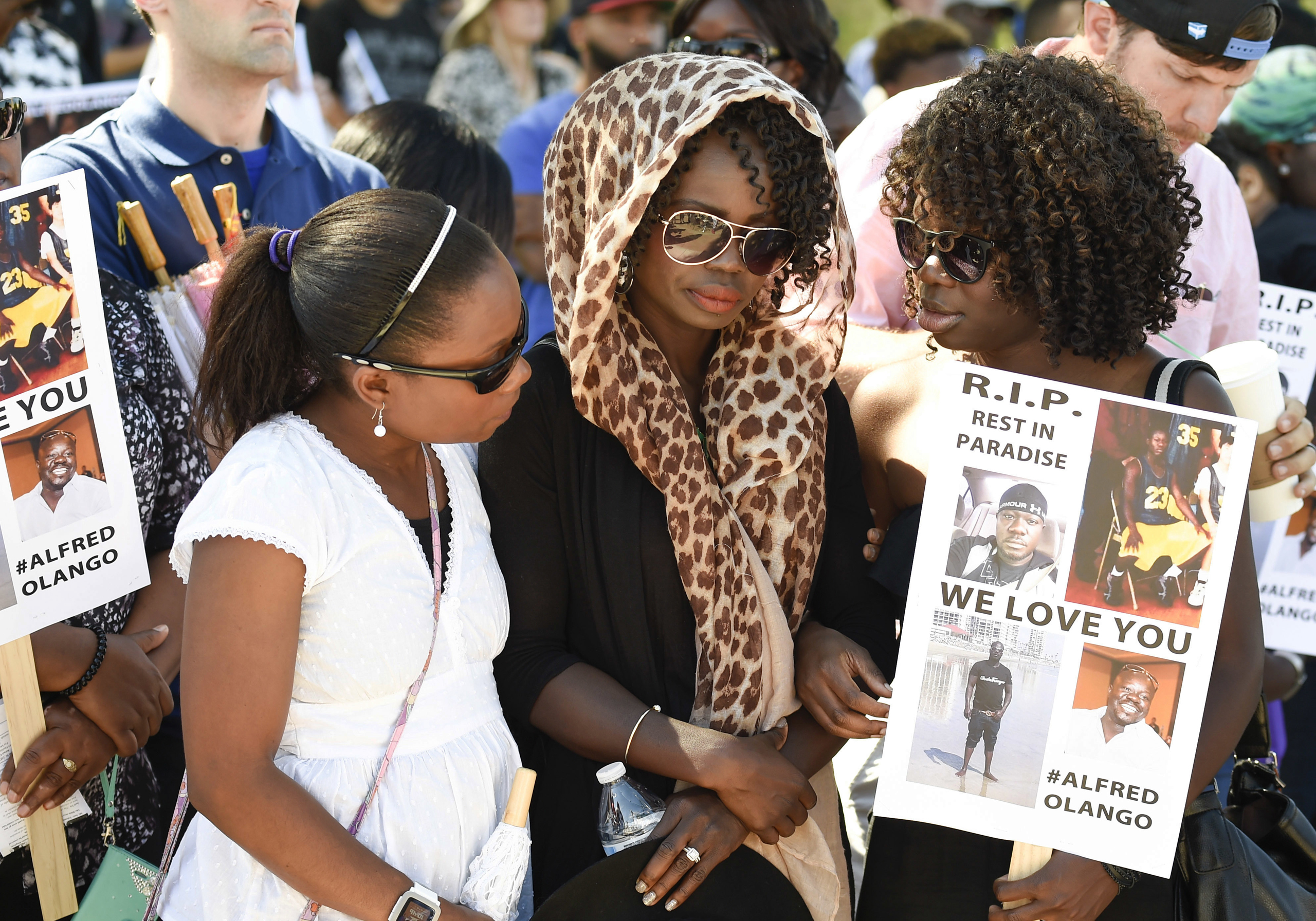 Winnie Olango, center, sister of Alfred Olango, is consoled by two friends before a march in reaction to the fatal police shooting of her brother, in El Cajon, Calif., on Oct. 1, 2016.