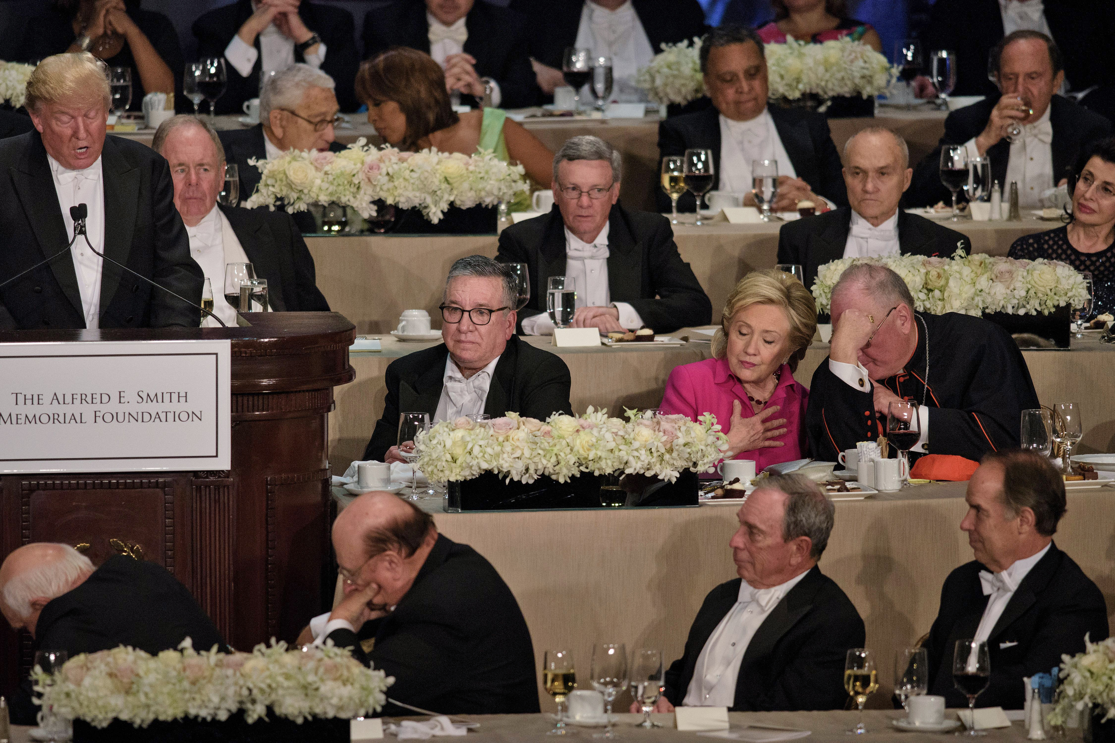 Hillary Clinton speaks with Timothy Cardinal Dolan, Archbishop of New York, as Republican presidential nominee Donald Trump speaks during the Alfred E. Smith Memorial Foundation Dinner at Waldorf Astoria in NYC, on Oct. 20, 2016. in New York, New York.