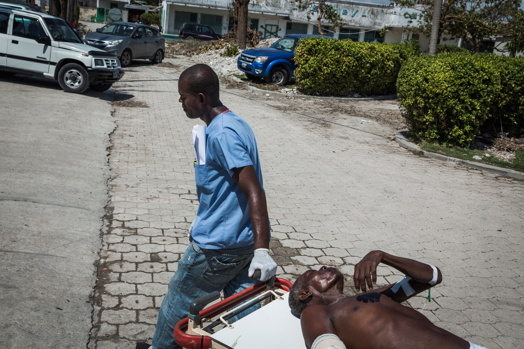 A woman who was severely injured during Hurricane Matthew is transferred between wards at the General Hospital in Les Cayes, Haiti, on Oct. 9, 2016.