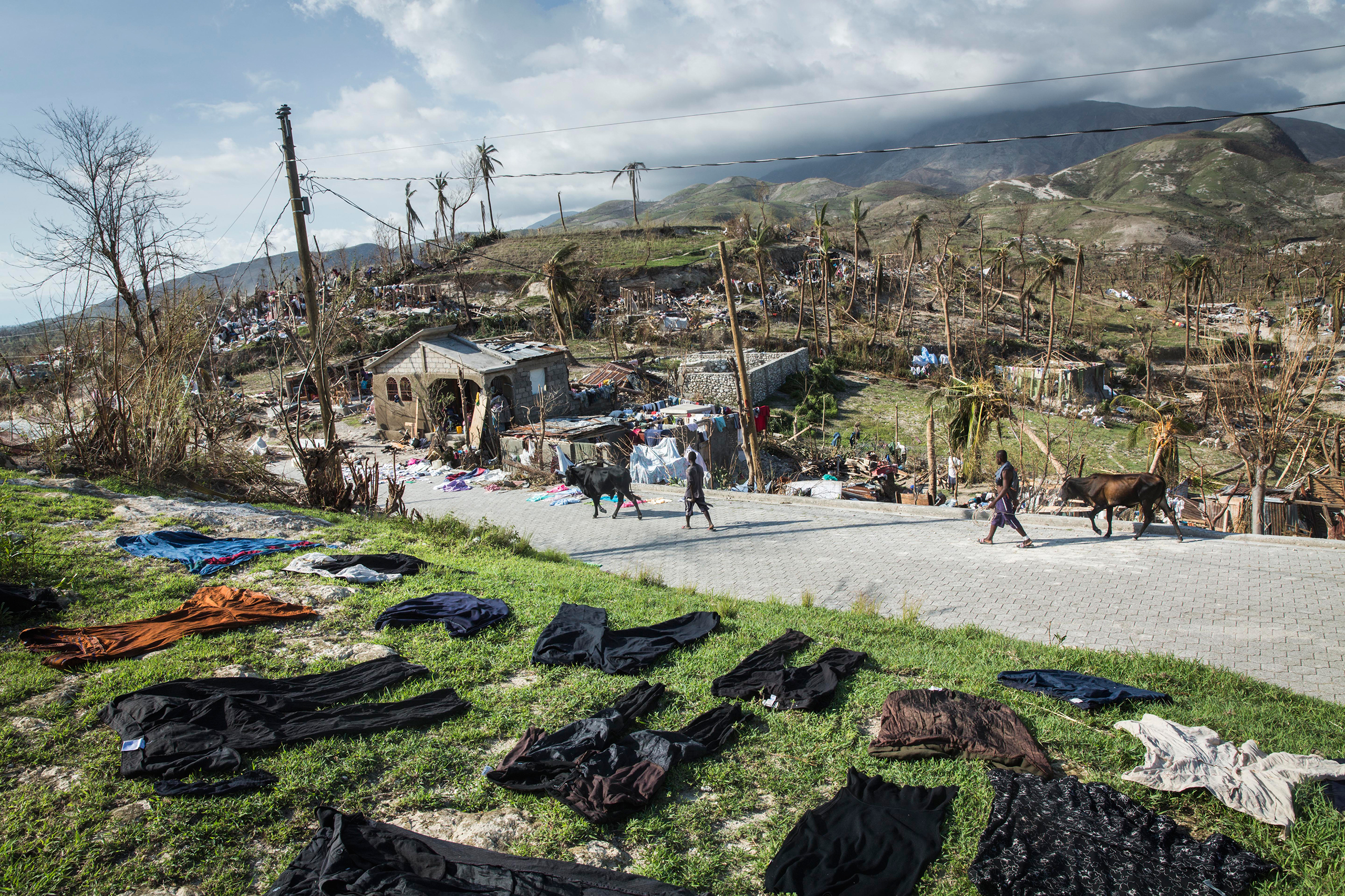 Clothes are dried on the ground in Roche-a-Bateau, southwestern Haiti, on Oct. 8, 2016.