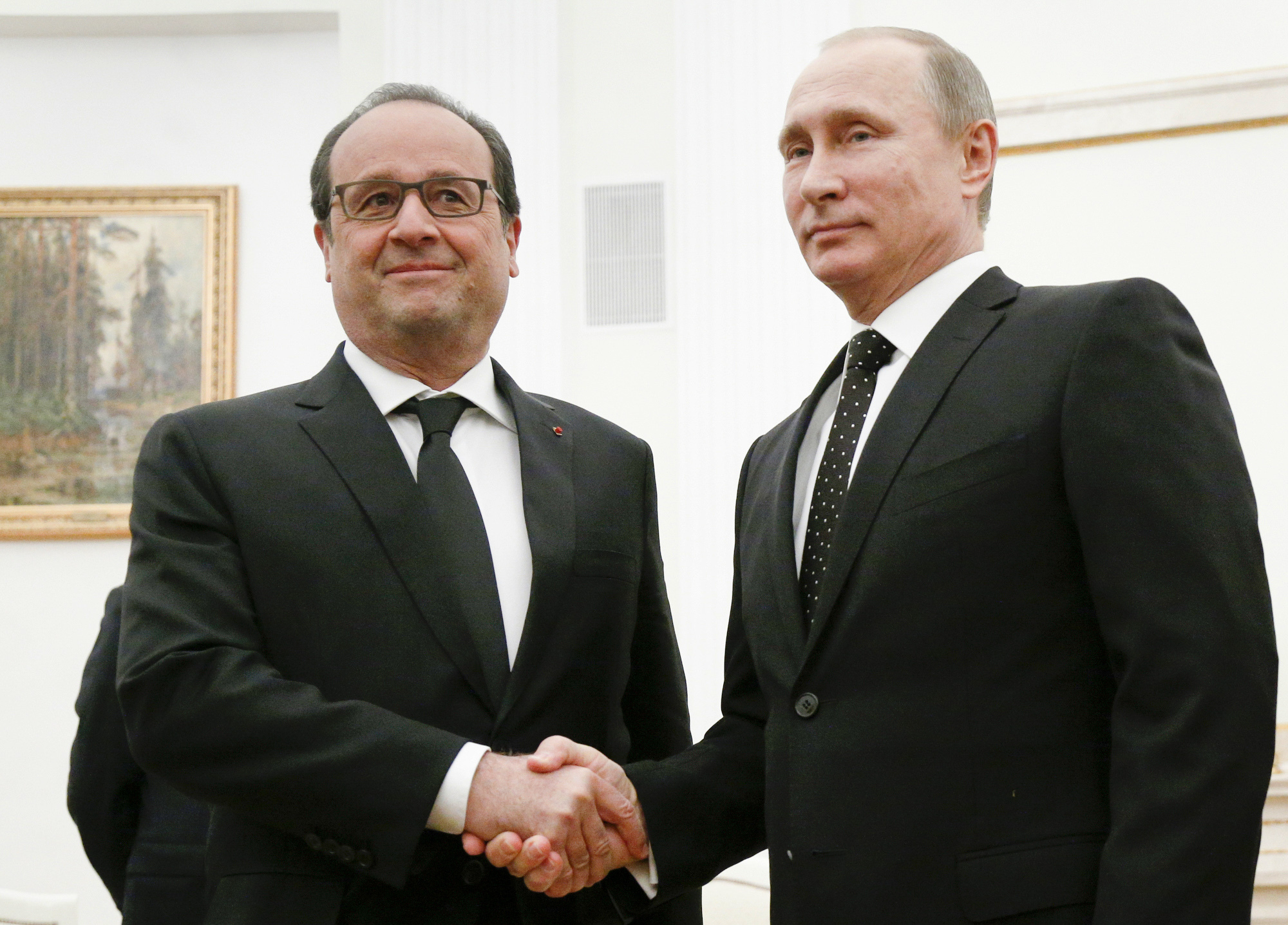 In this Thursday, Nov. 26, 2015 file photo, Russian President Vladimir Putin, right, shakes hands with his French counterpart Francois Hollande during their meeting in Moscow, Russia. (AP Photo/Alexander Zemlianichenko, Pool, File)