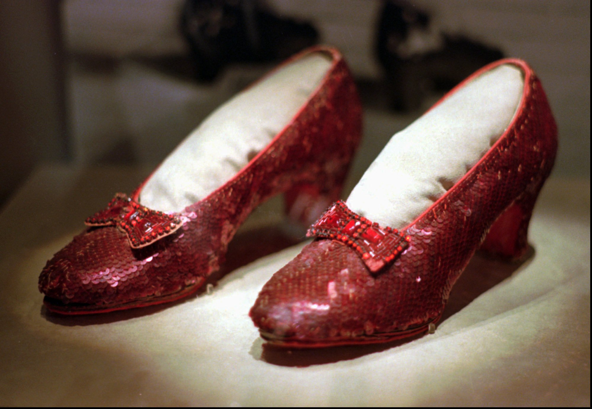 FILE - In this April 10, 1996 file photo, the ruby slippers worn by Judy Garland in the 1939 film  The Wizard of Oz  are shown on display during a media tour of the  America's Smithsonian  exhibition in Kansas City, Mo.   The ruby slippers are leaving the U.S.  on their first international journey to London's Victoria and Albert Museum.  (AP Photo/Ed Zurga)