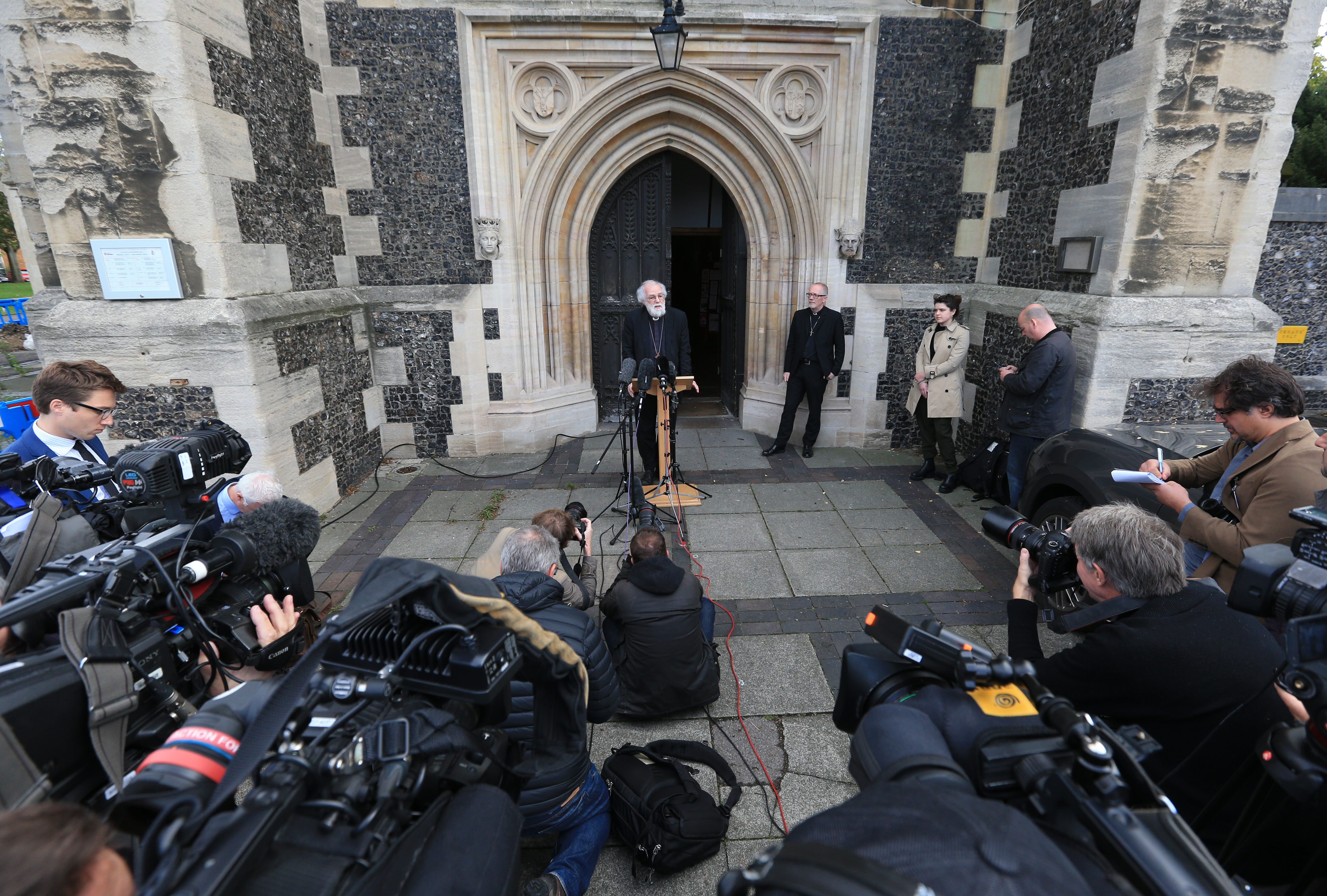 Former Archbishop of Canterbury Dr Rowan Williams speaks to reporters outside Croydon Minster, Croydon, as efforts to resettle migrant children from the Calais  Jungle  are stepped up. Picture date: Monday October 17, 2016.