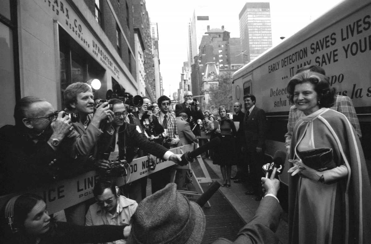 First lady Betty Ford, right, answers questions from the press prior to her tour of the Guttman Institute for Early Detection of Breast Cancer in New York City on Nov. 7, 1975.