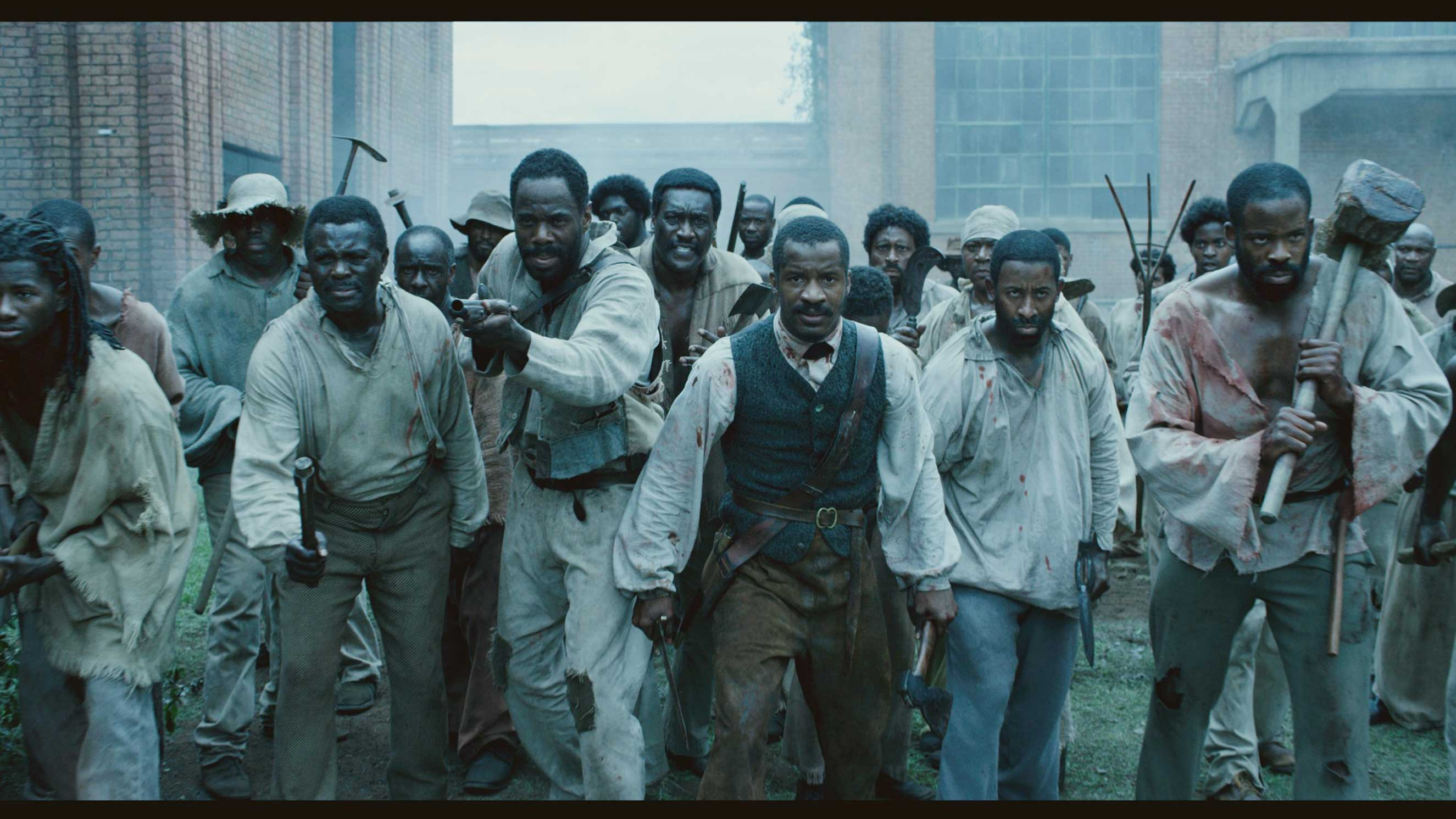 """(From L-R:) Colman Domingo as """"Hark,"""" Nate Parker as """"Nat Turner,"""" and Chike Okonkwo as """"Will"""" in THE BIRTH OF A NATION."""
