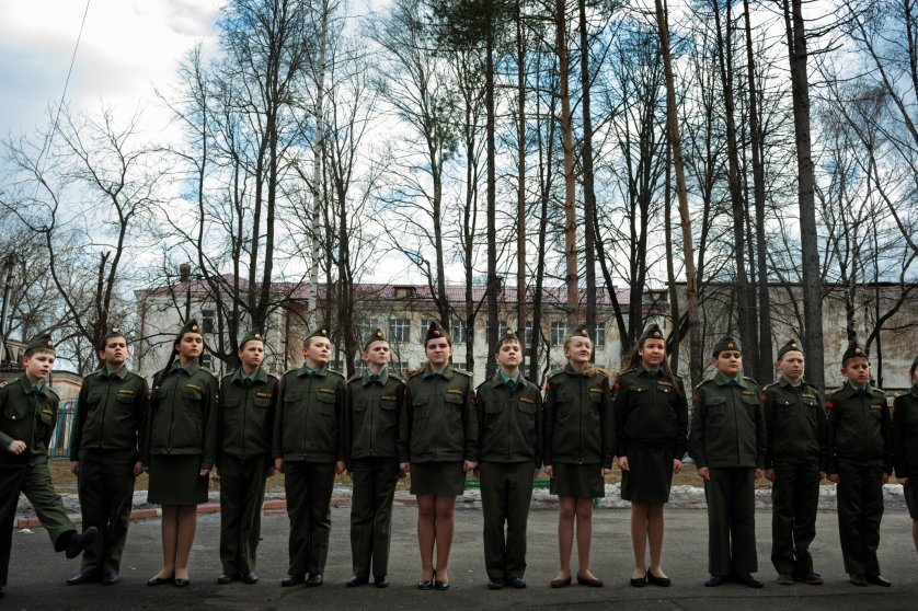 Schoolchildren line up for drills at a public school in Dmitrov, Russia. Drills are not mandatory but those who wish to participate receive free lunch, while other students have to pay.