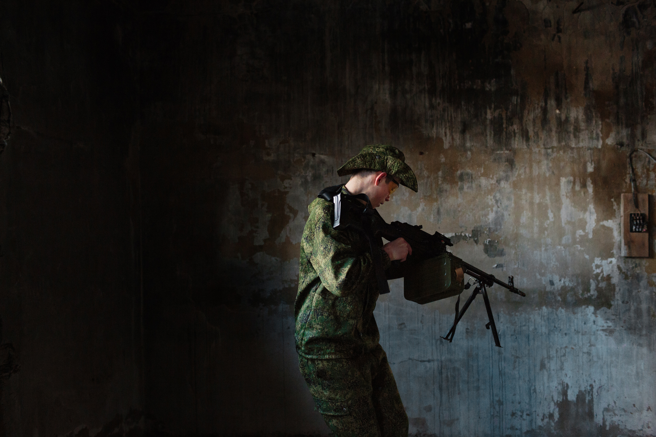 Artyom Baklashkin, 17, a student of the local secondary school in the village of Diveevo, stands guard in an abandoned building with a group known as the  Survivalists . They meet weekly after school with their physical education instructor, and train to survive future wars and post-apocalyptic life. They are using airsoft guns for the practice and competition. Air-soft is a sport that replicates military action, but fires non-lethal pellets.