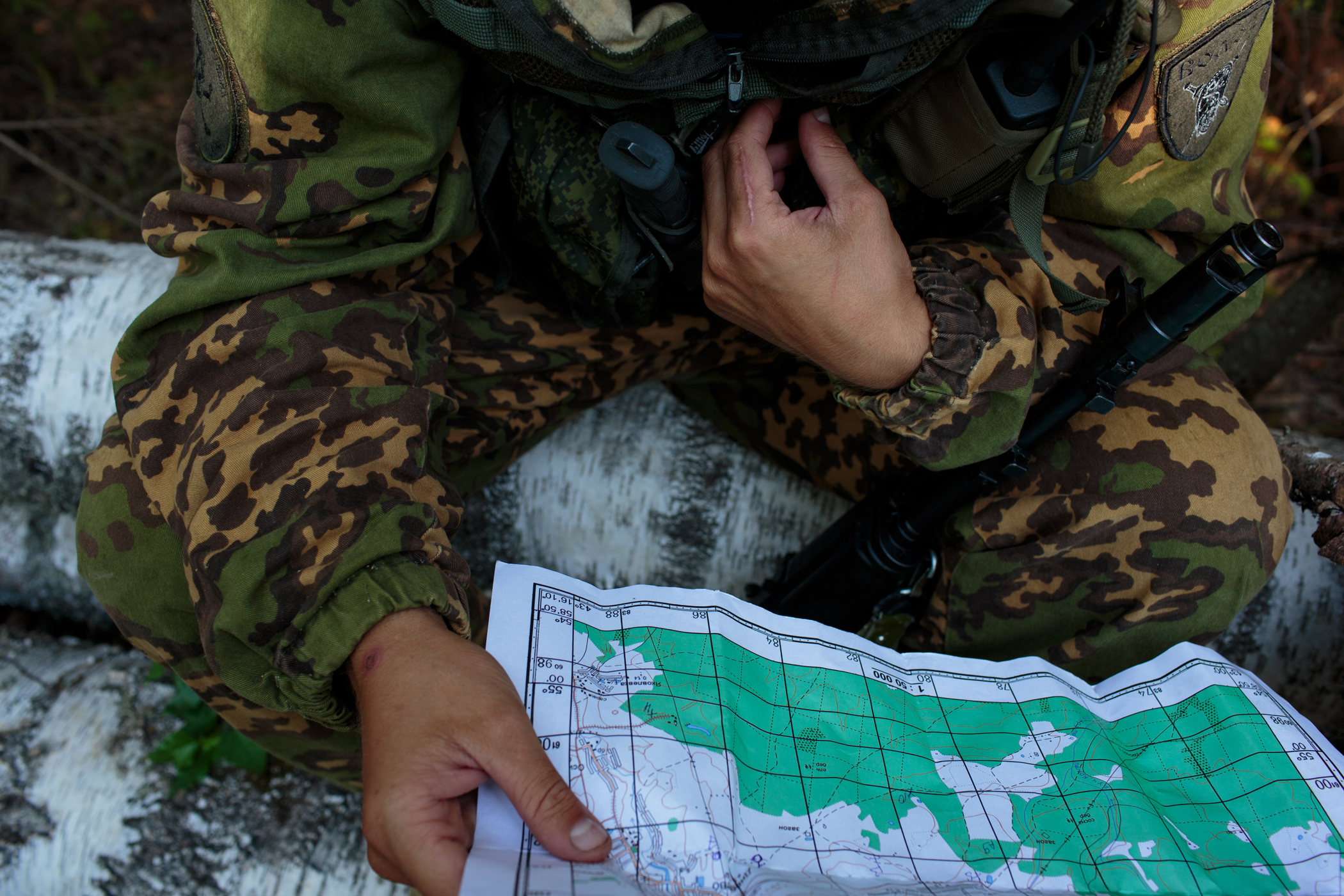 Evgeni (Jenya) Riabyxin, 22, from Stavropol studies a map during a twelve-hour drill in the forests surrounding Diveevo, Russia.