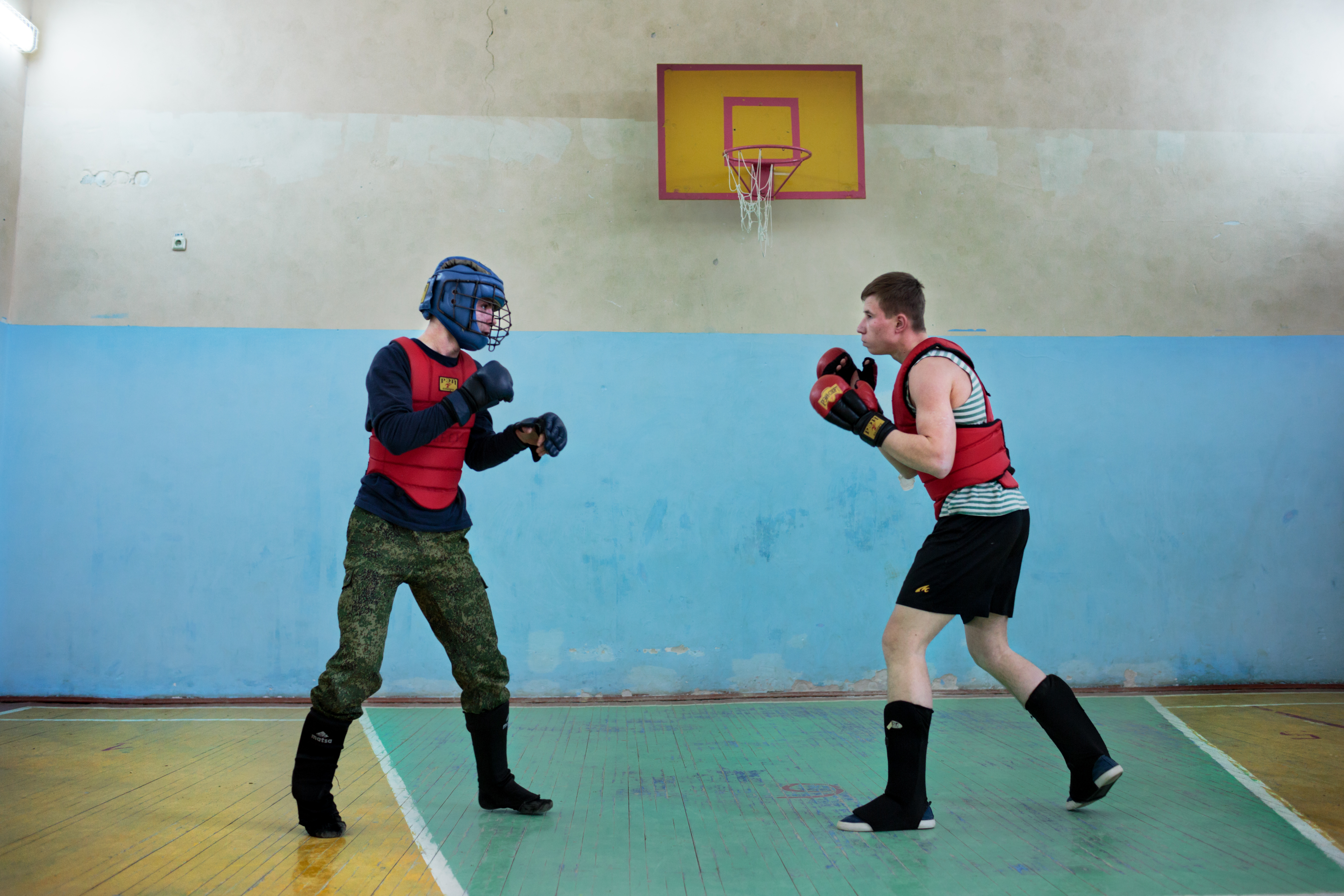 Students practice boxing and martial arts after school at the Diveevo Public School gymnasium on Apr. 6, 2016 in Diveevo, Russia.