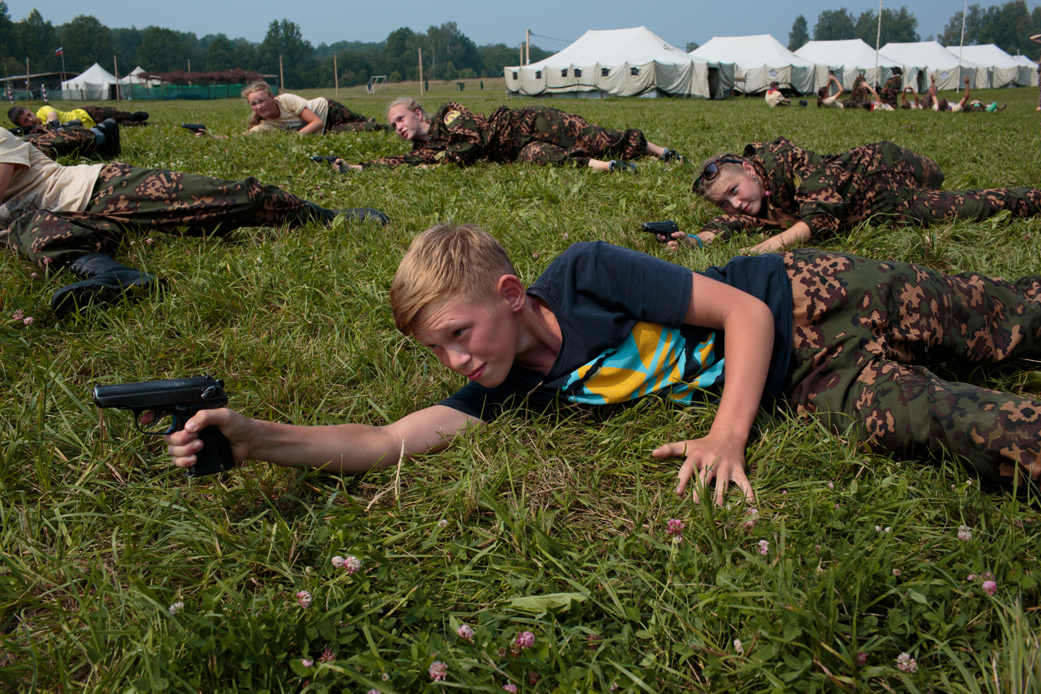 Campers practice shooting air soft guns at a Historical War Camp in Borodino, Russia. Borodino is where the deadliest day of the Napoleonic War was fought in 1812. 350 kids ages 11 to 17 attend the camp. It teaches campers about weapons, bases, and warfare.                                                               The project statement of the camp reads:  To awaken in the younger generation a keen interest in the history of the Fatherland, the glorious deeds of our ancestors, to facilitate the expansion of military-historical knowledge.