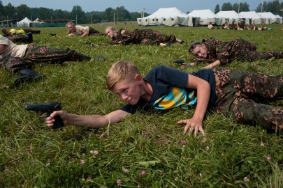"Students practice shooting air soft guns at a Historical-War Camp in Borodino, Russia. Borodino is where the deadliest day of the Napoleonic War was fought in 1812. 350 kids attend the camp, ranging in age from 11 to 17. It teaches campers about weapons, bases, and warfare. The project statement of the camp says: ""To awaken in the younger generation a keen interest in the history of the Fatherland, the glorious deeds of our ancestors, to facilitate the expansion of military-historical knowledge."""