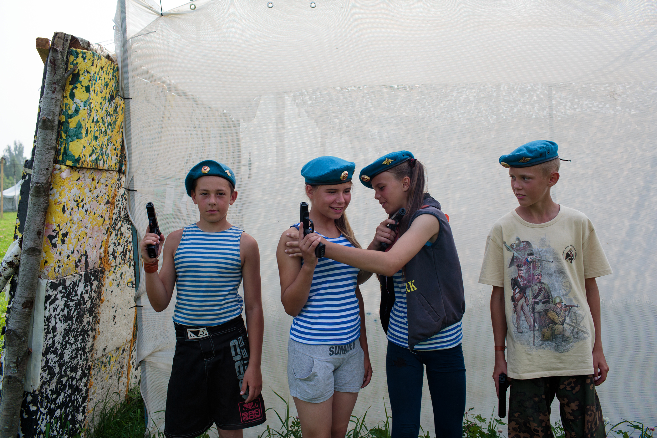 Students dressed in traditional Russian air force hats and shirts pose for a portrait during a firearm drill at the Historical-War Camp, in Borodino, Russia.