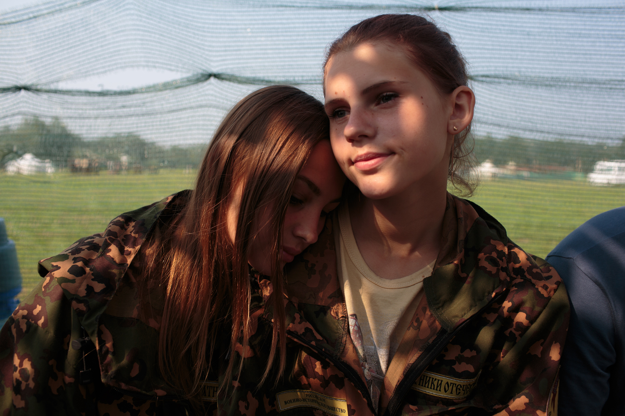 Left, Nastya Gobritskaya, from Moscow and Alina Klikova from Medin rest between tactical drills at the Historical-War Camp, in Borodino, Russia.