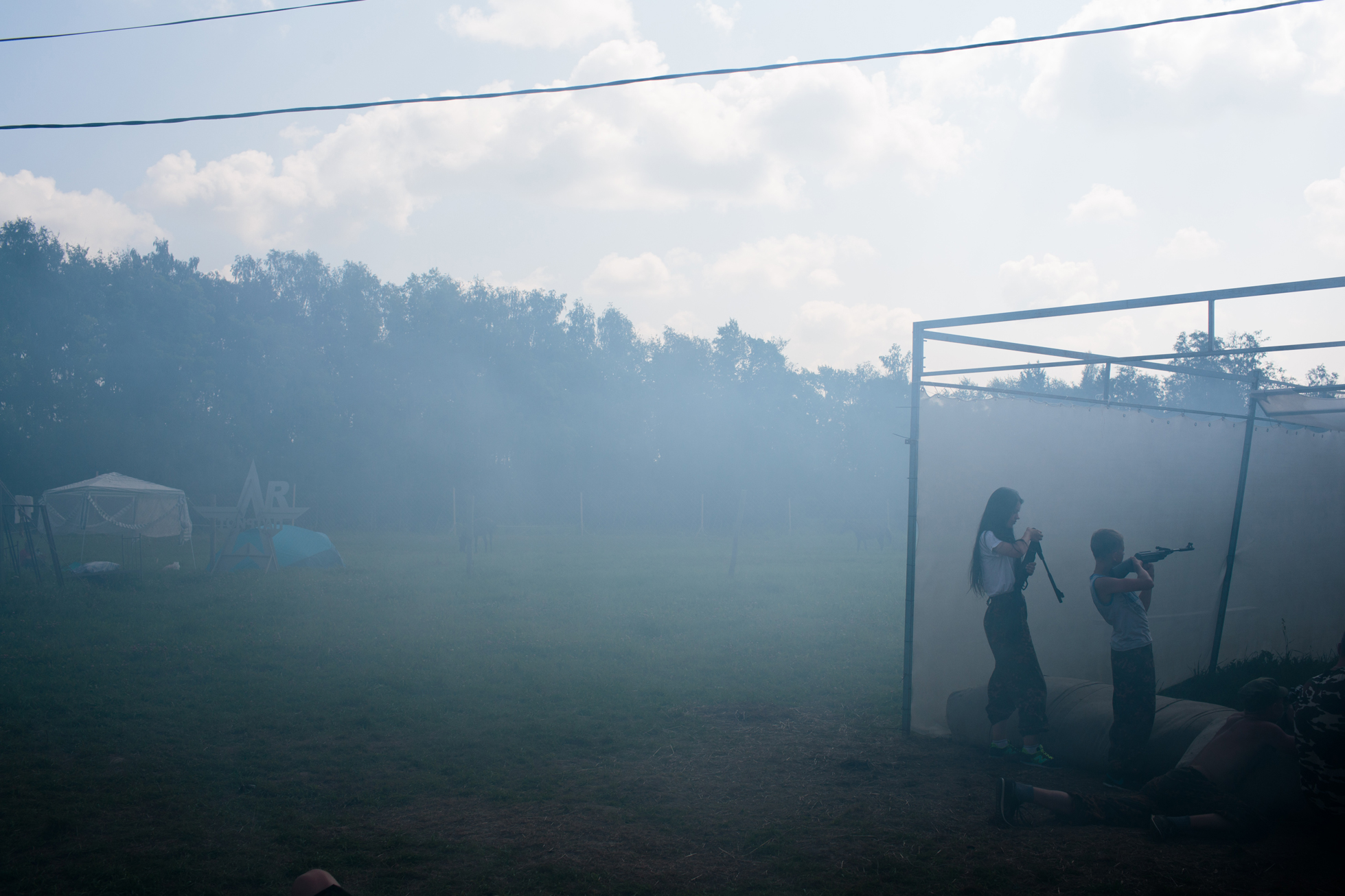 Campers at target practice. The smoke is from launching fake grenades.