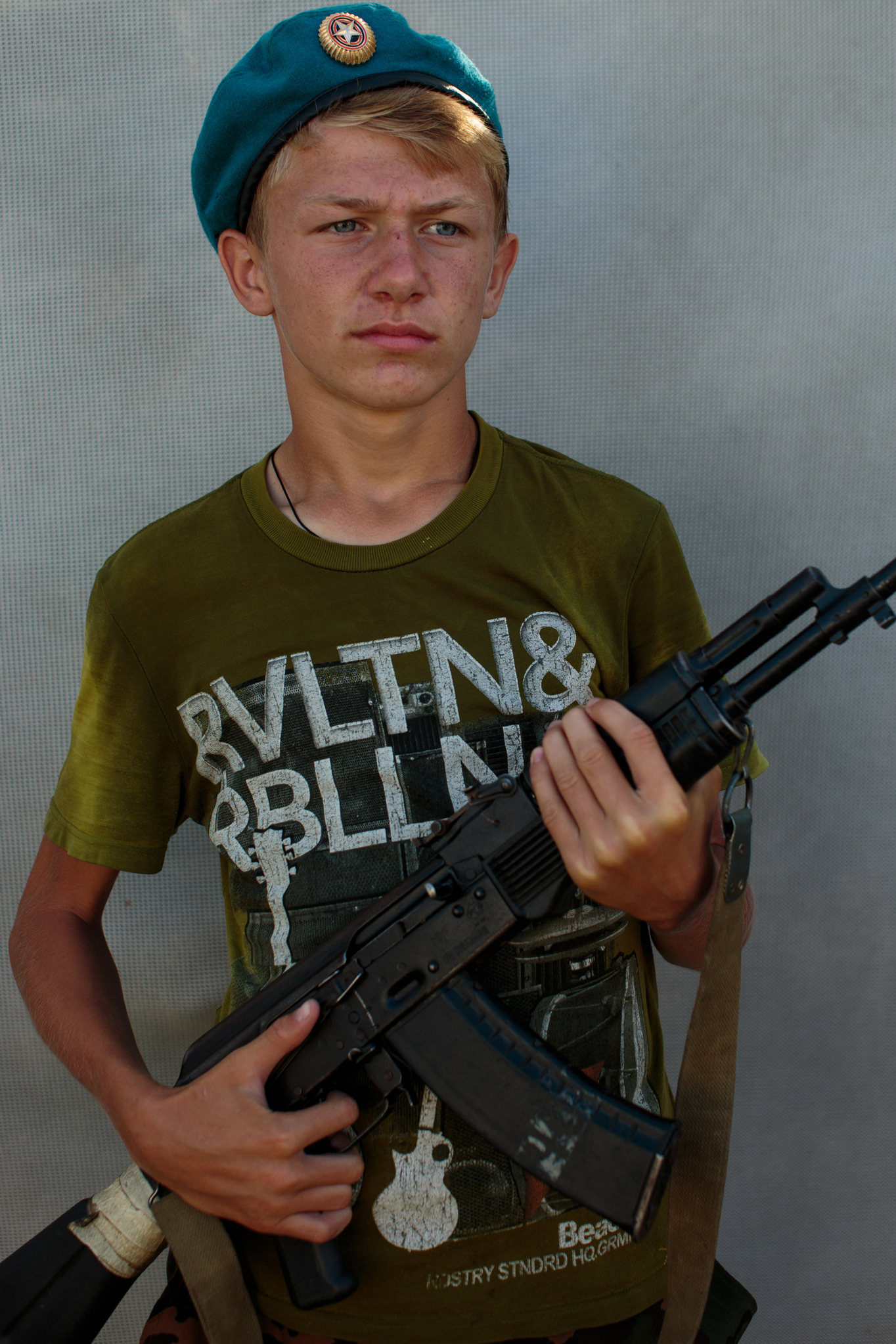 Vladimir Ribak, 14, from Moscow poses with a real but non firing gun used solely for drills.