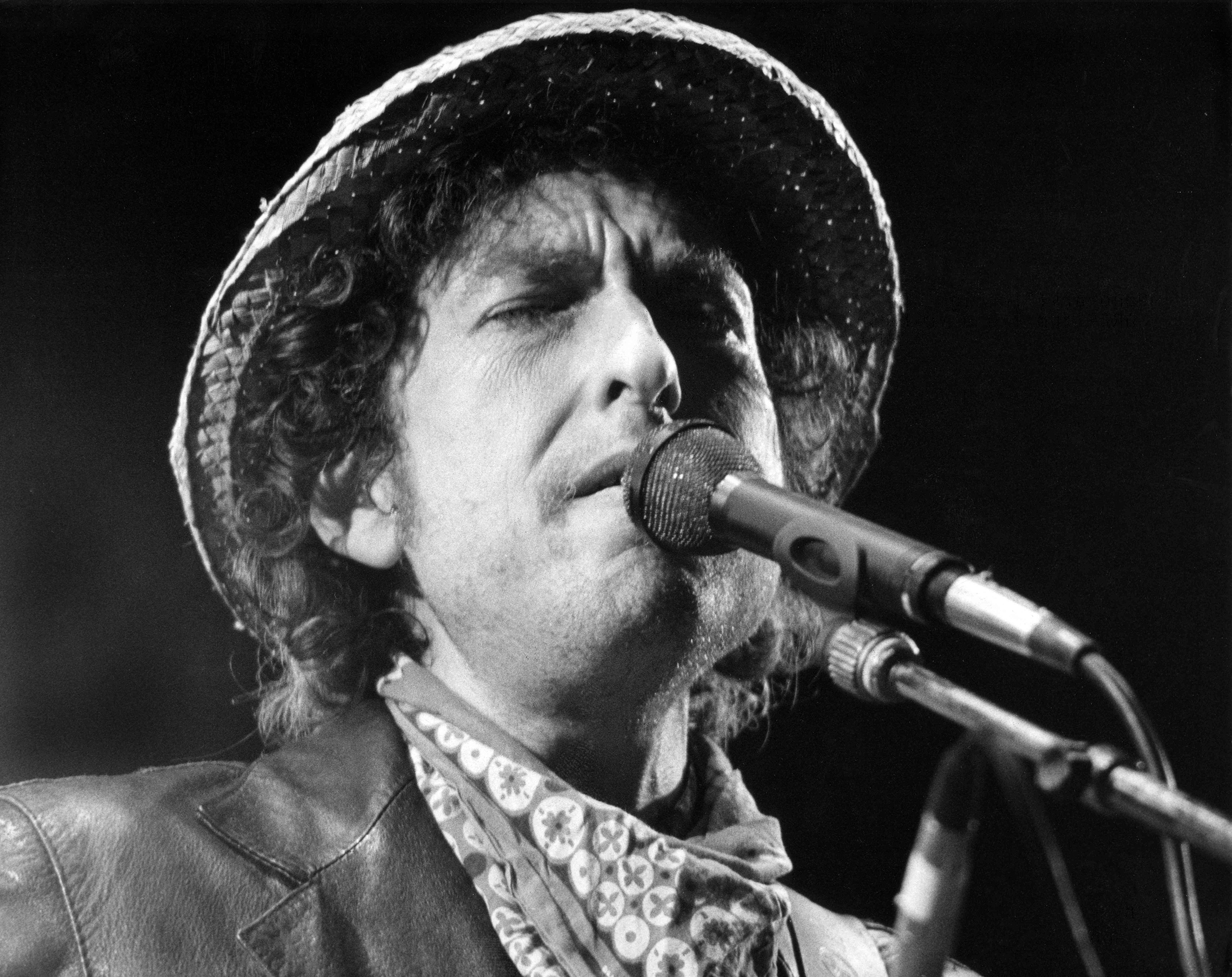 Bob Dylan performs during a concert at the Olympic stadium in Munich, southern Germany, on June 3, 1984. Dylan won the Nobel Prize in Literature on Oct. 13, 2016.