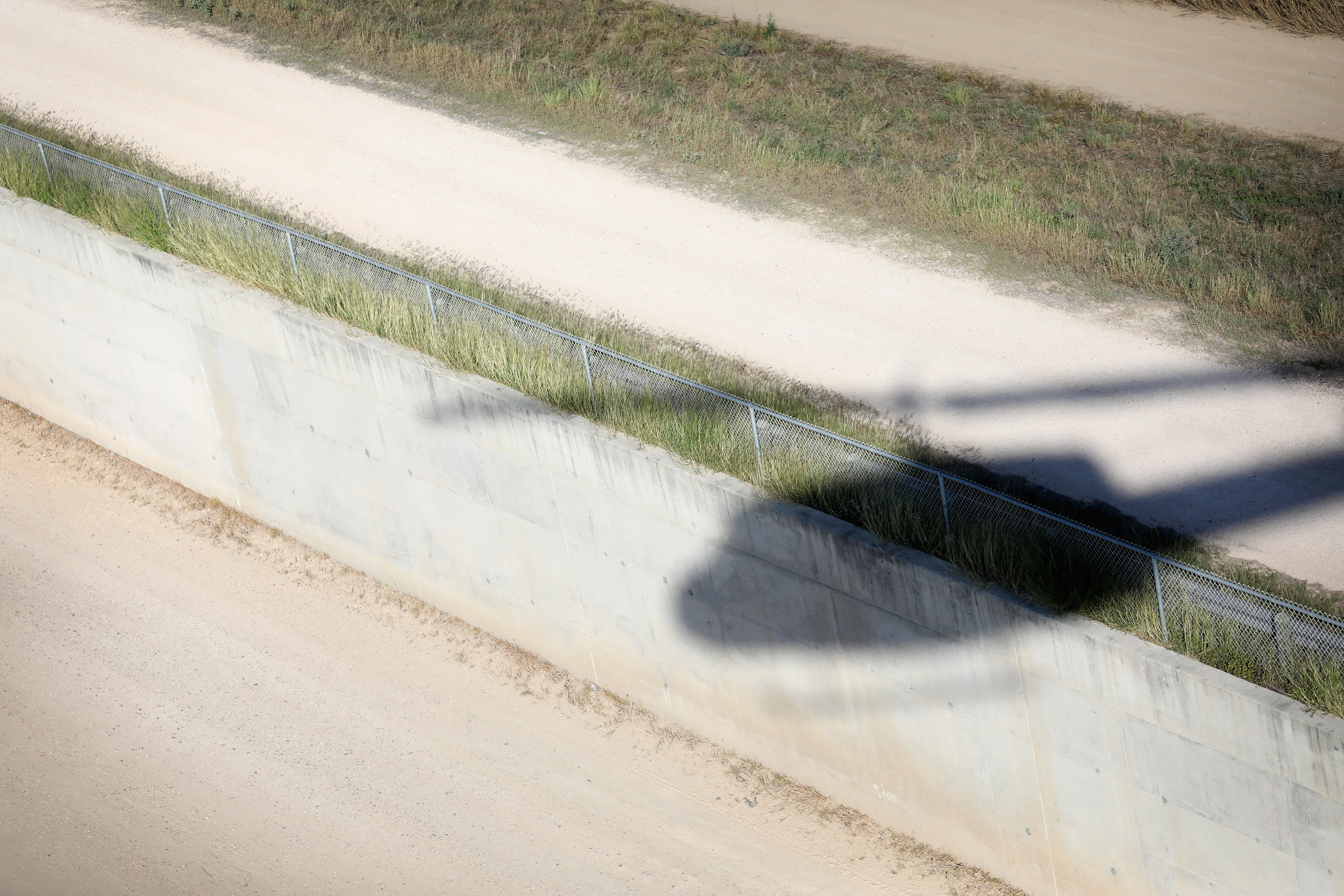 A U.S. Customs and Border Protection helicopter flies over a border fence at the U.S.-Mexico border on a patrol on October 18, 2016 near McAllen, Texas.