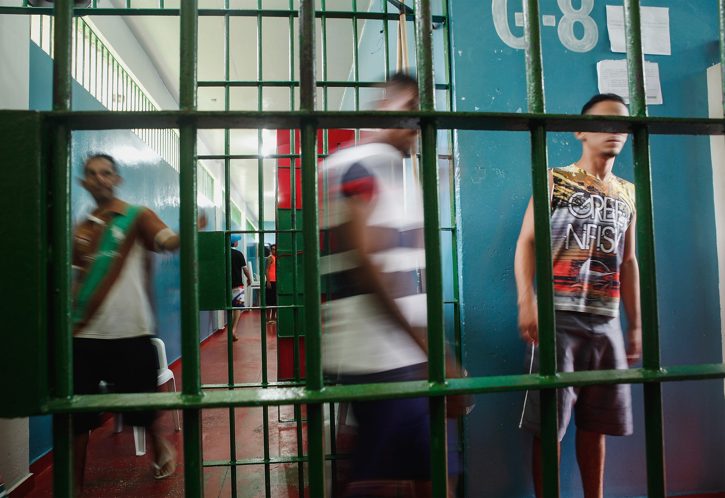 Inmates gather in the overcrowded Puraquequara prison on February 18, 2016 in Manaus, Brazil.