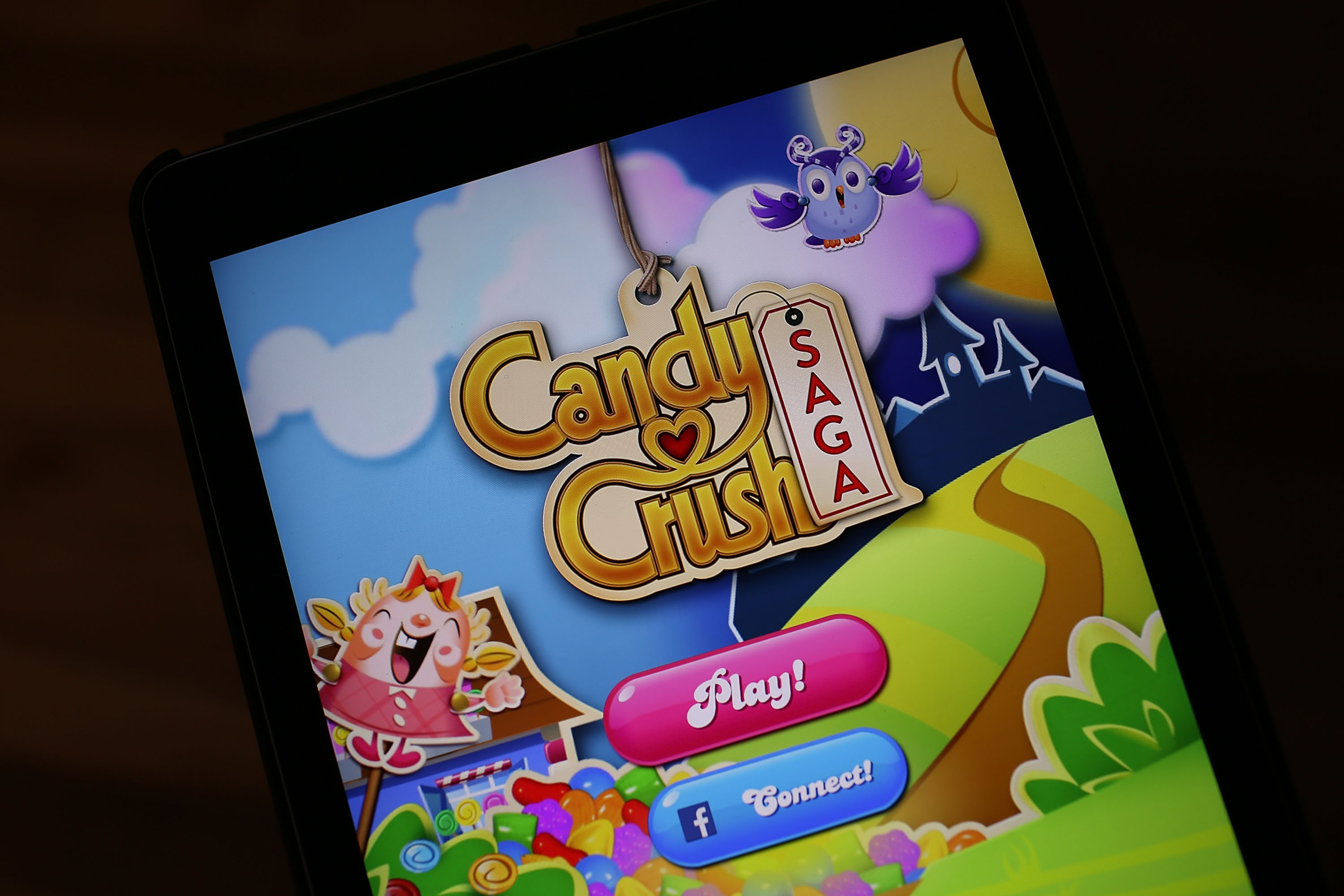 In this photo illustration, a Candy Crush game is seen on an iPad on November 3, 2015 in Miami, Florida. It was announced today that game maker Activision Blizzard has paid $5.9 billion to purchase King, the parent company of games like Candy Crush Saga and Bubble Witch Saga.